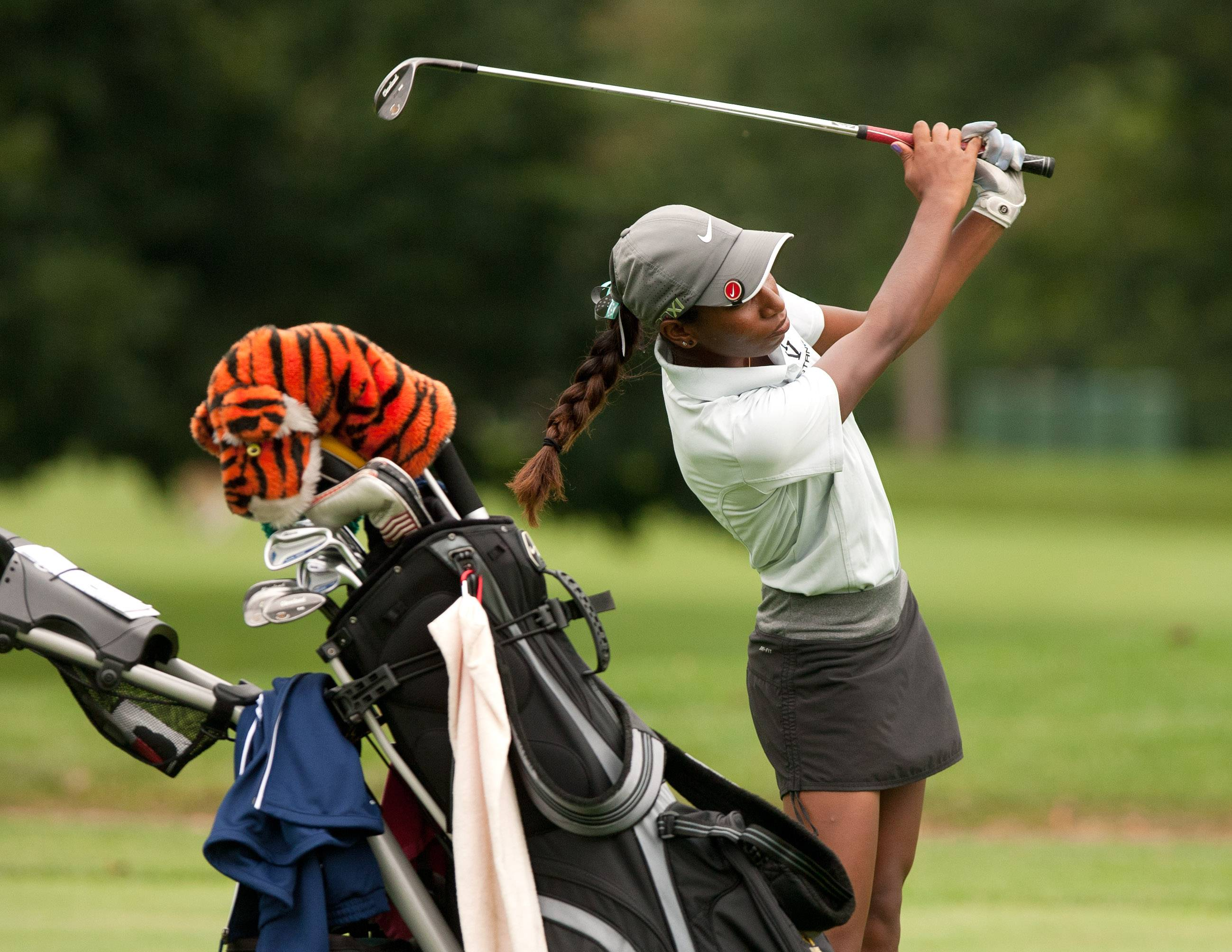 "Metea Valley""s Niquole Mangal eyes the green during the Vern McGonagle Memorial High School Golf Championship at the Naperville Country Club."