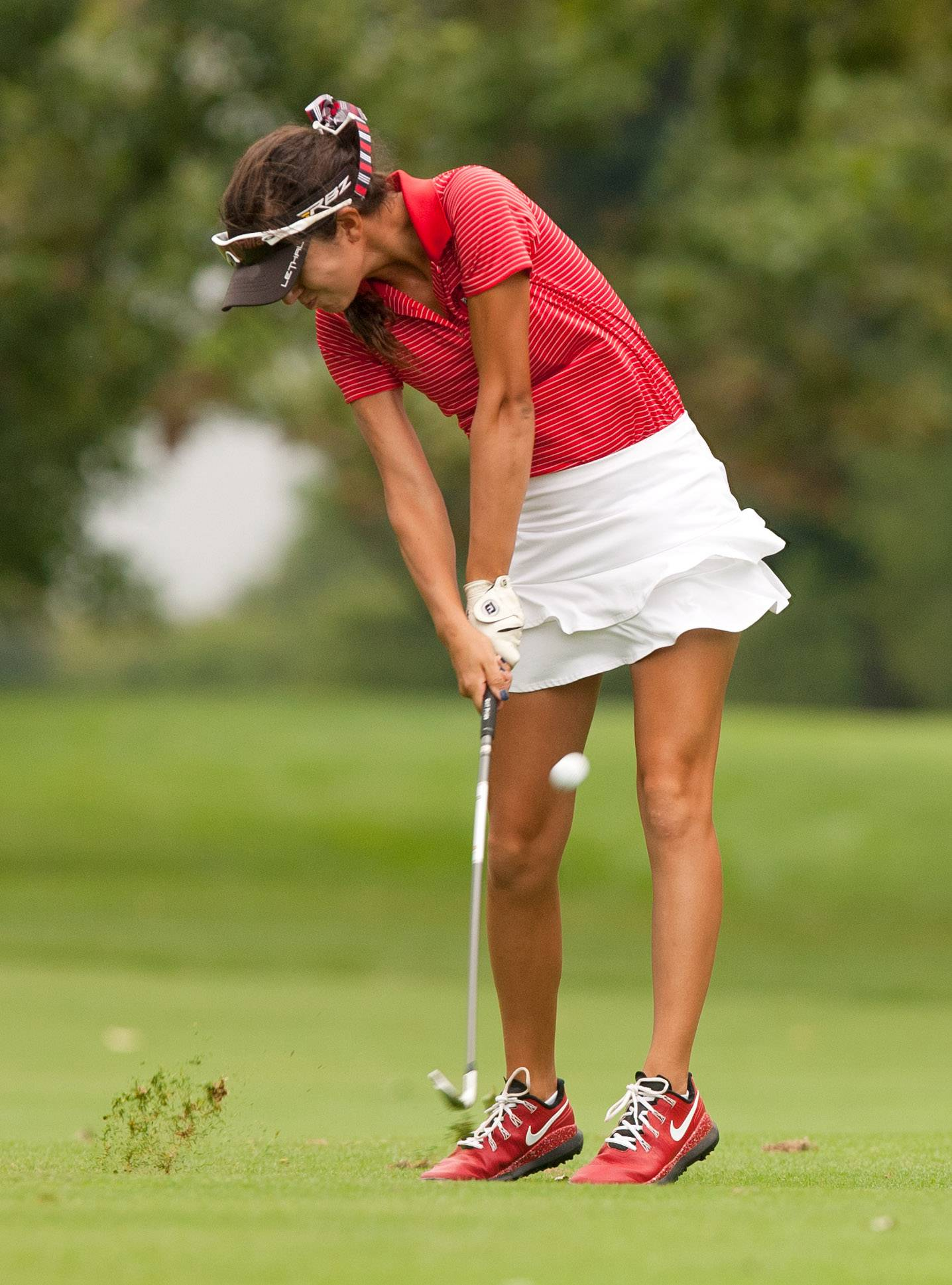 Benet's Isabella Abdullah approaches the green during the Vern McGonagle Memorial High School Golf Championship at the Naperville Country Club.