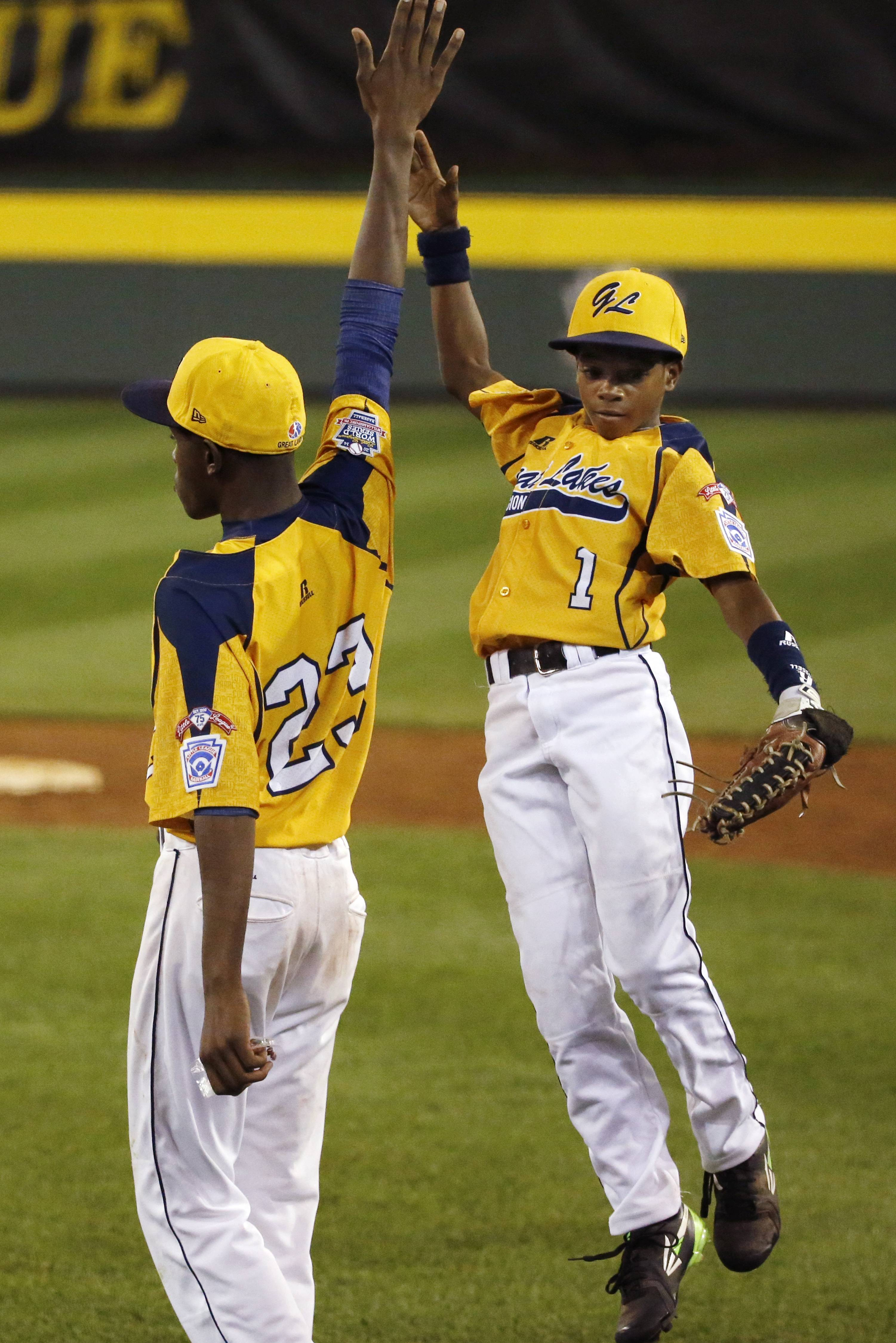 Chicago players Pierce Jones (23) and DJ Butler (1) celebrate a 6-1 win over Pearland in an elimination baseball game at the Little League World Series tournament in South Williamsport, Pa., Tuesday, Aug. 19, 2014.