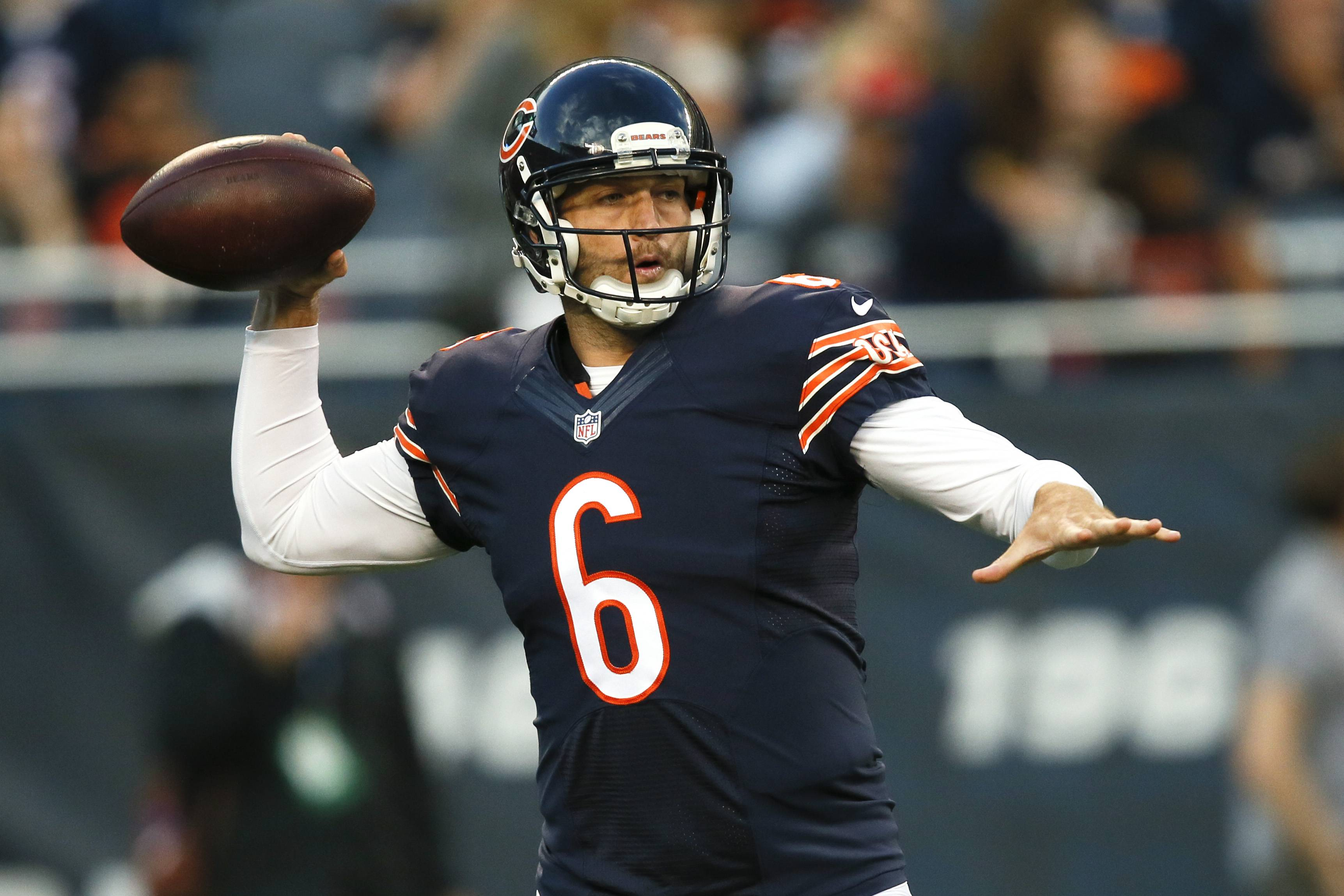 Bears quarterback Jay Cutler (6) passes during the first half of an NFL preseason football game against the Jacksonville Jaguars in Chicago, Thursday, Aug. 14, 2014.