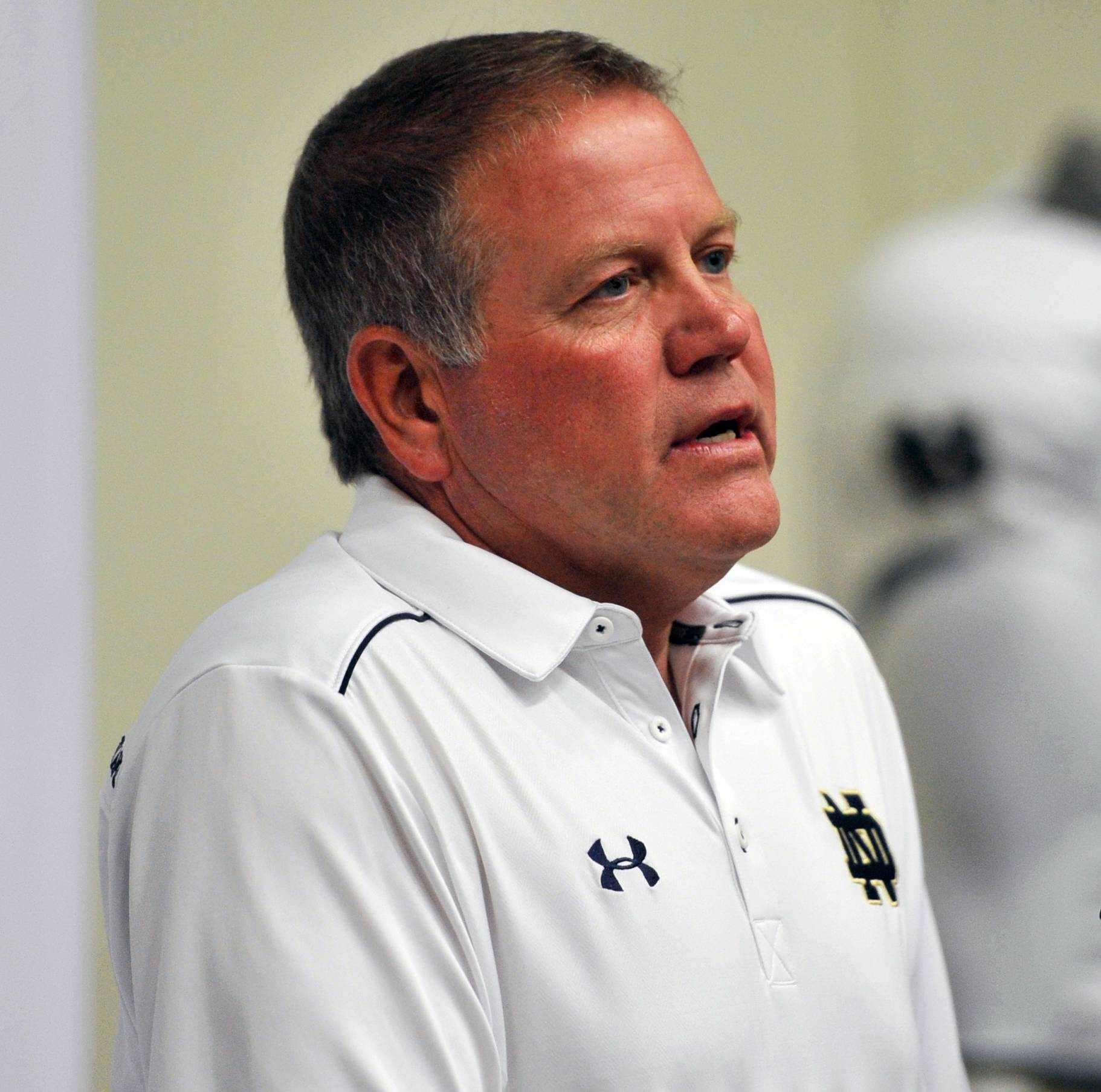 Notre Dame coach Brian Kelly talks to the media during media day for the NCAA college football team Tuesday Aug. 19, 2014,  in South Bend, Ind.