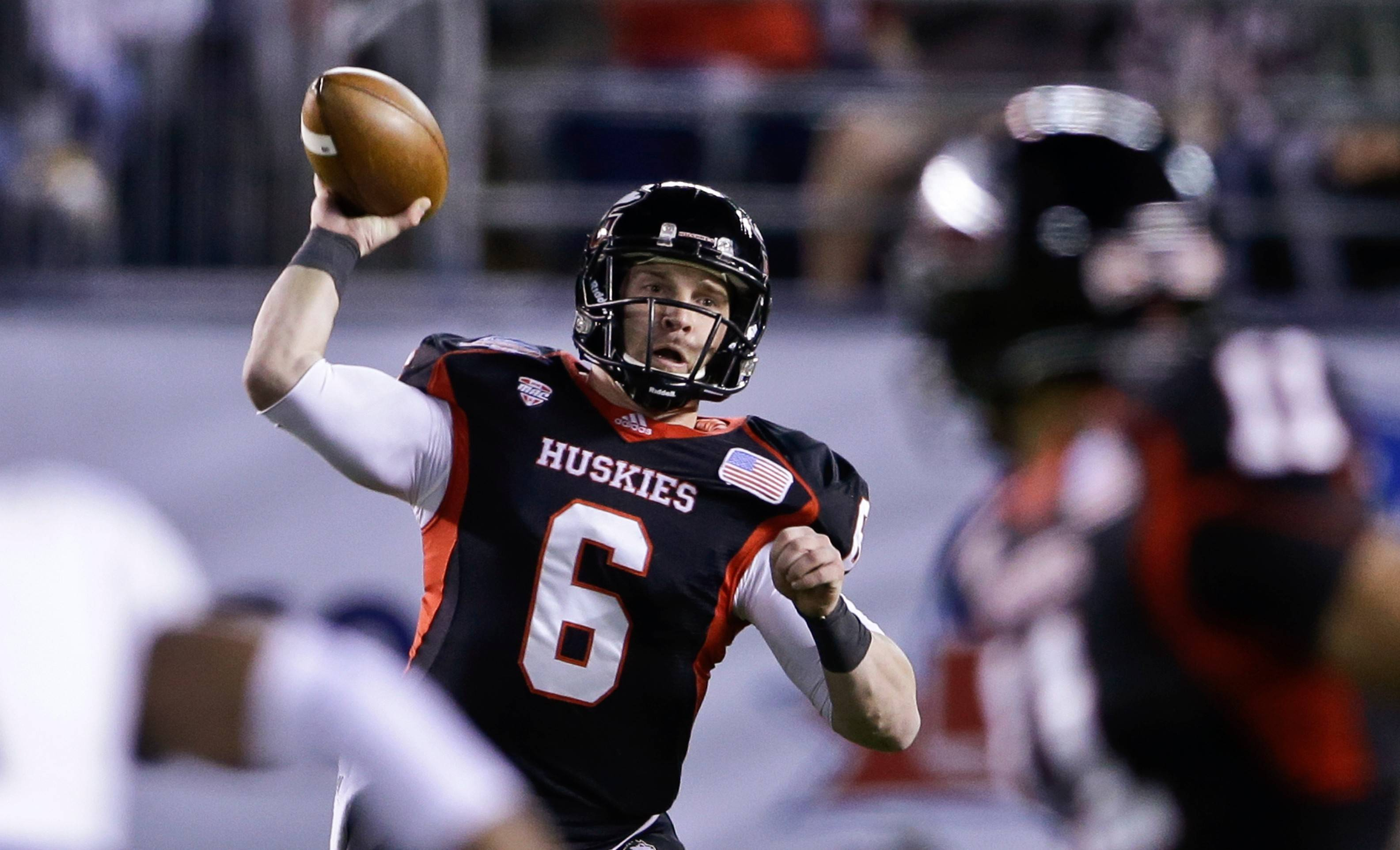 Northern Illinois quarterback Jordan Lynch throws a pass against Utah State in Poinsettia Bowl in San Diego. ESPN and the MAC officially announced a 13-year media rights agreement.