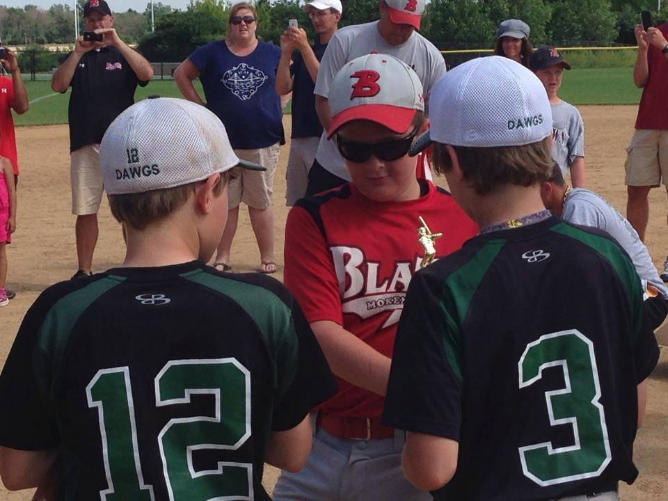 Members of the Mokena Blaze and Racine RiverDawgs show good sportsmanship following the 11U Championship of the 21st annual Seminole Classic at Olympic Park in Schaumburg.