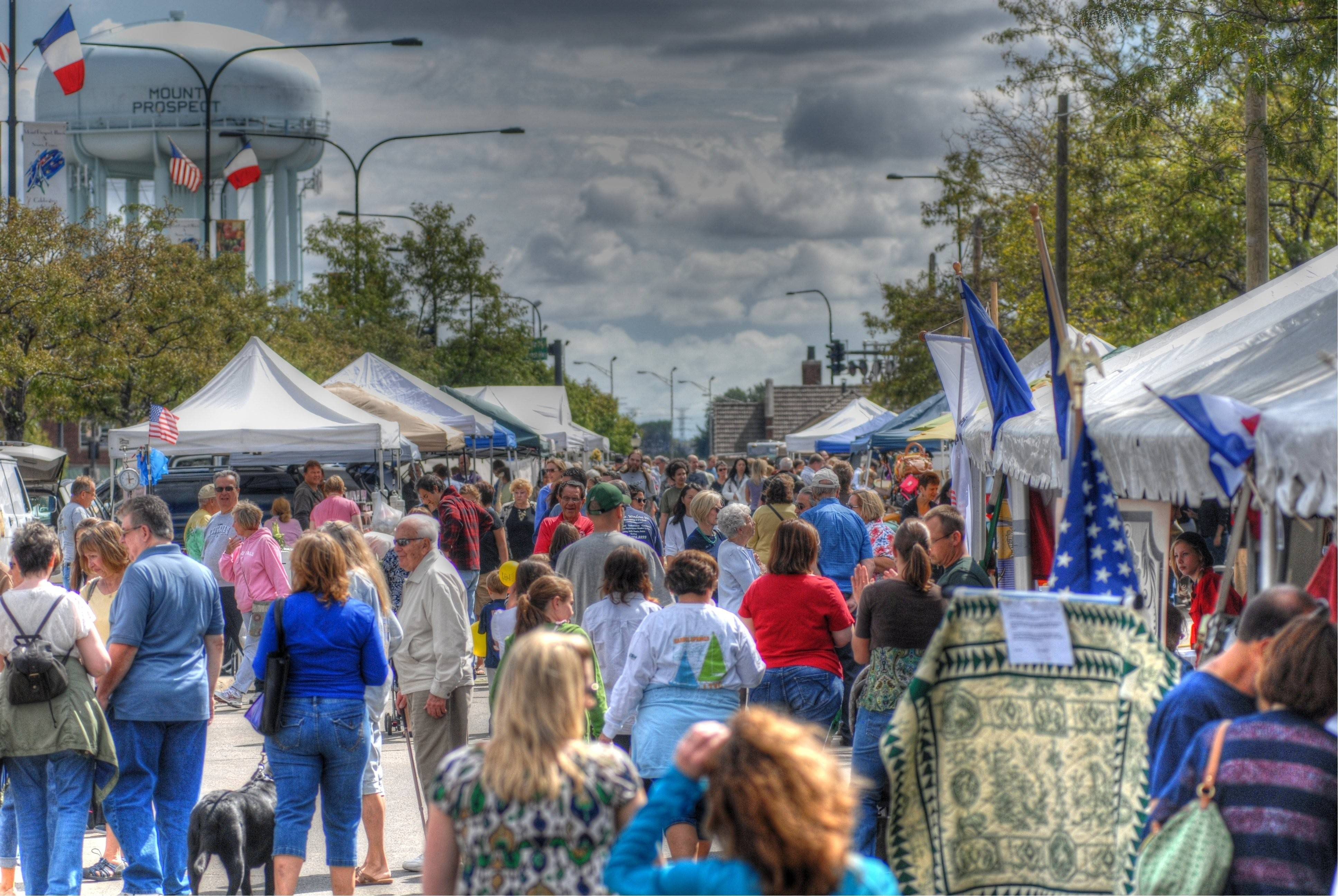 People enjoy a recent French market in downtown Mount Prospect.