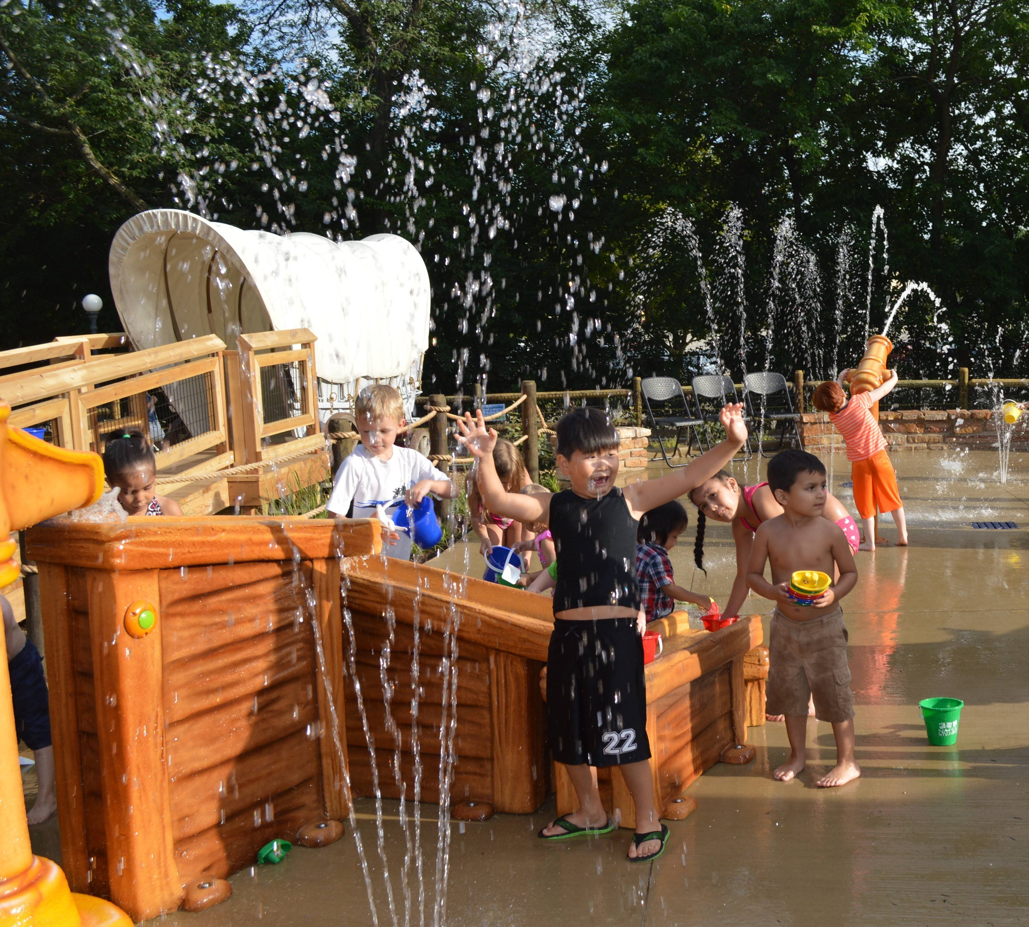 Naper Settlement's Early Learning Playscape includes a water area where visitors can cool off on a warm day.