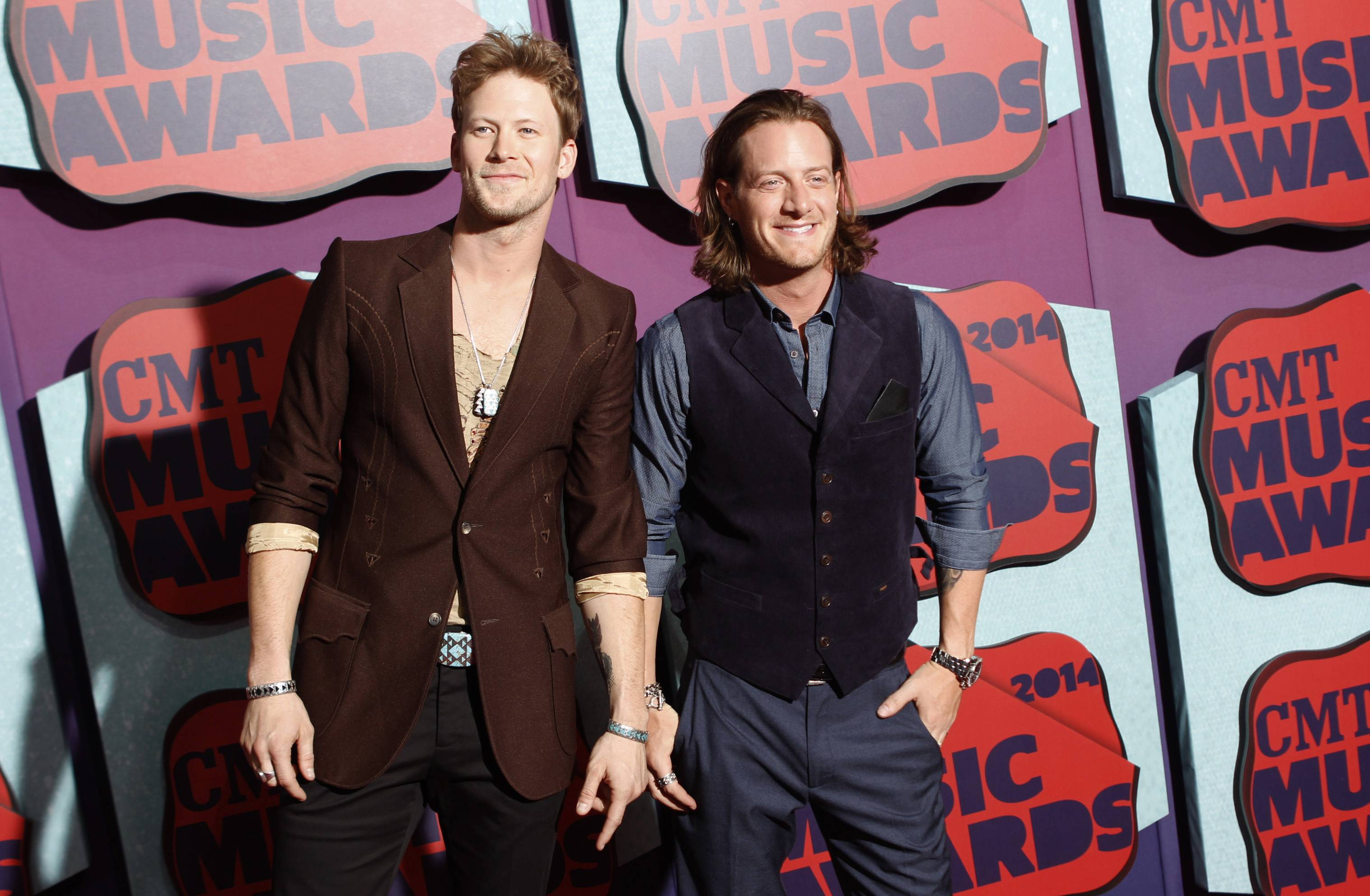 "Brian Kelley, left, and Tyler Hubbard of Florida Georgia Line will release their latest album, ""Anything Goes,"" on Oct. 14."