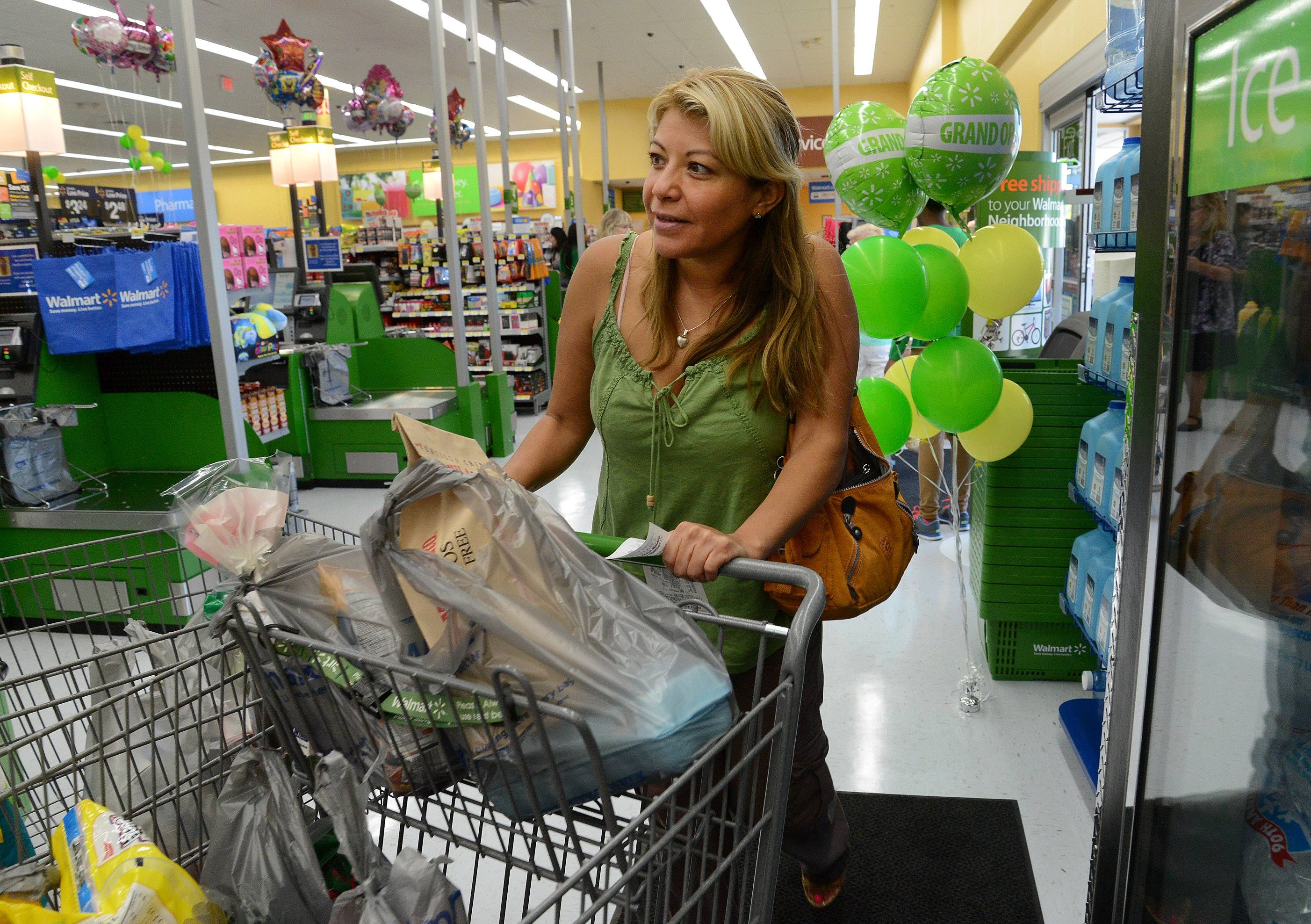 Erika Stientjes of Des Plaines fills her cart on the opening day of the new Walmart Neighborhood Market in Des Plaines.