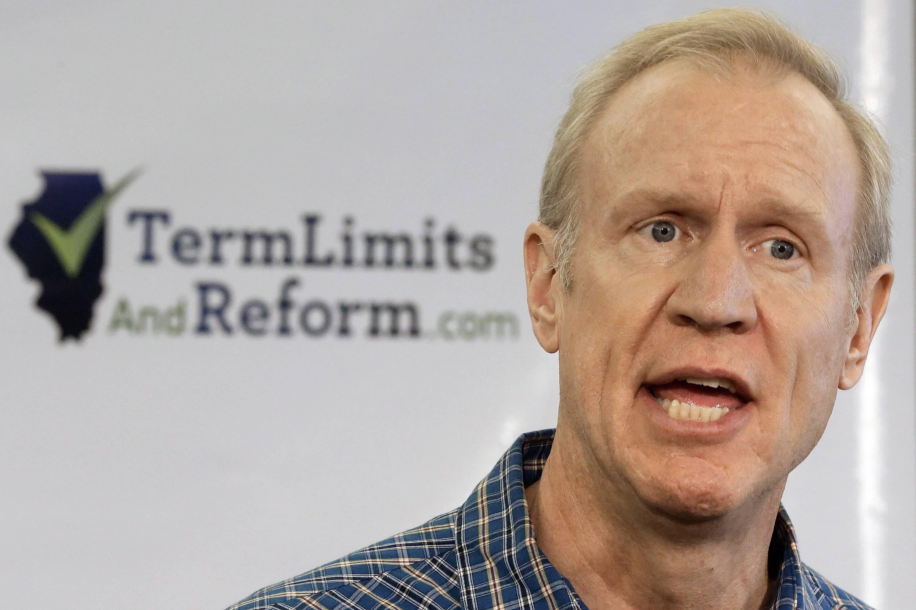 Republican gubernatorial candidate Bruce Rauner speaks with reporters during a term limits news conference Tuesday in Springfield.
