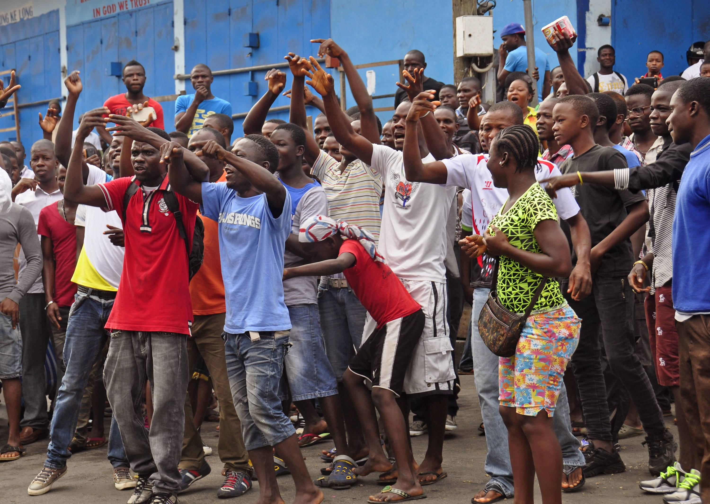 Residents protest not being allowed to enter the area leading to their homes. Security forces deployed Wednesday to enforce a quarantine around a slum in the Liberian capital, stepping up the government's fight to stop the spread of Ebola and unnerving residents.