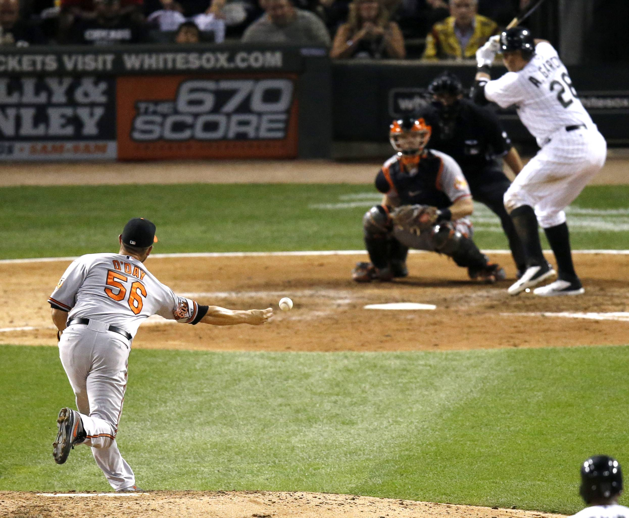 Baltimore Orioles relief pitcher Darren O'Day pitches to Chicago White Sox's Leury Garcia, during the eighth inning of a baseball game Wednesday, Aug. 20, 2014, in Chicago. Orioles' won 4-3. (AP Photo/Charles Rex Arbogast)
