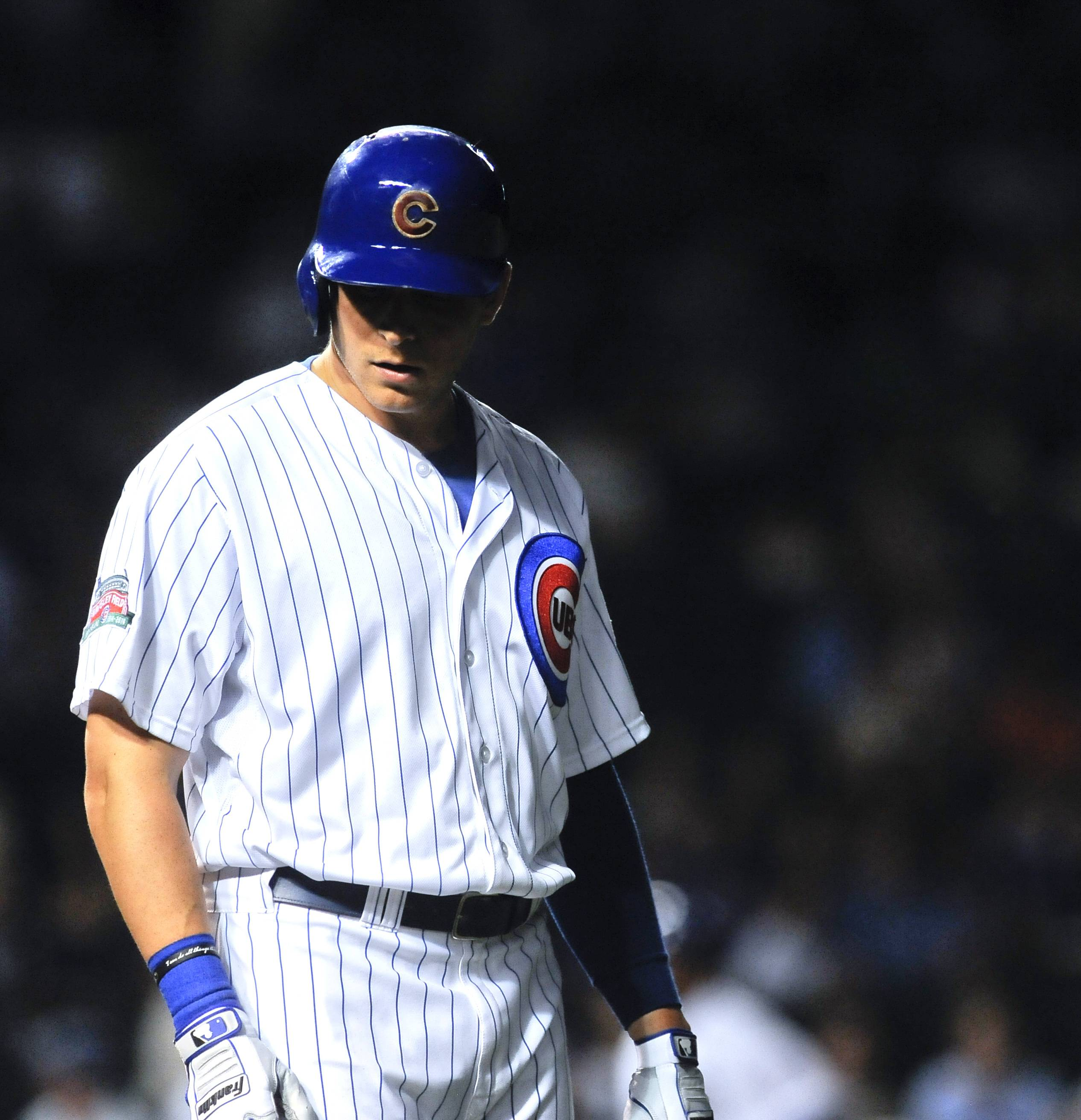 Chicago Cubs center fielder Ryan Sweeney grounds out to first base in the eighth inning of a baseball game against the San Francisco Giants on Wednesday in Chicago.