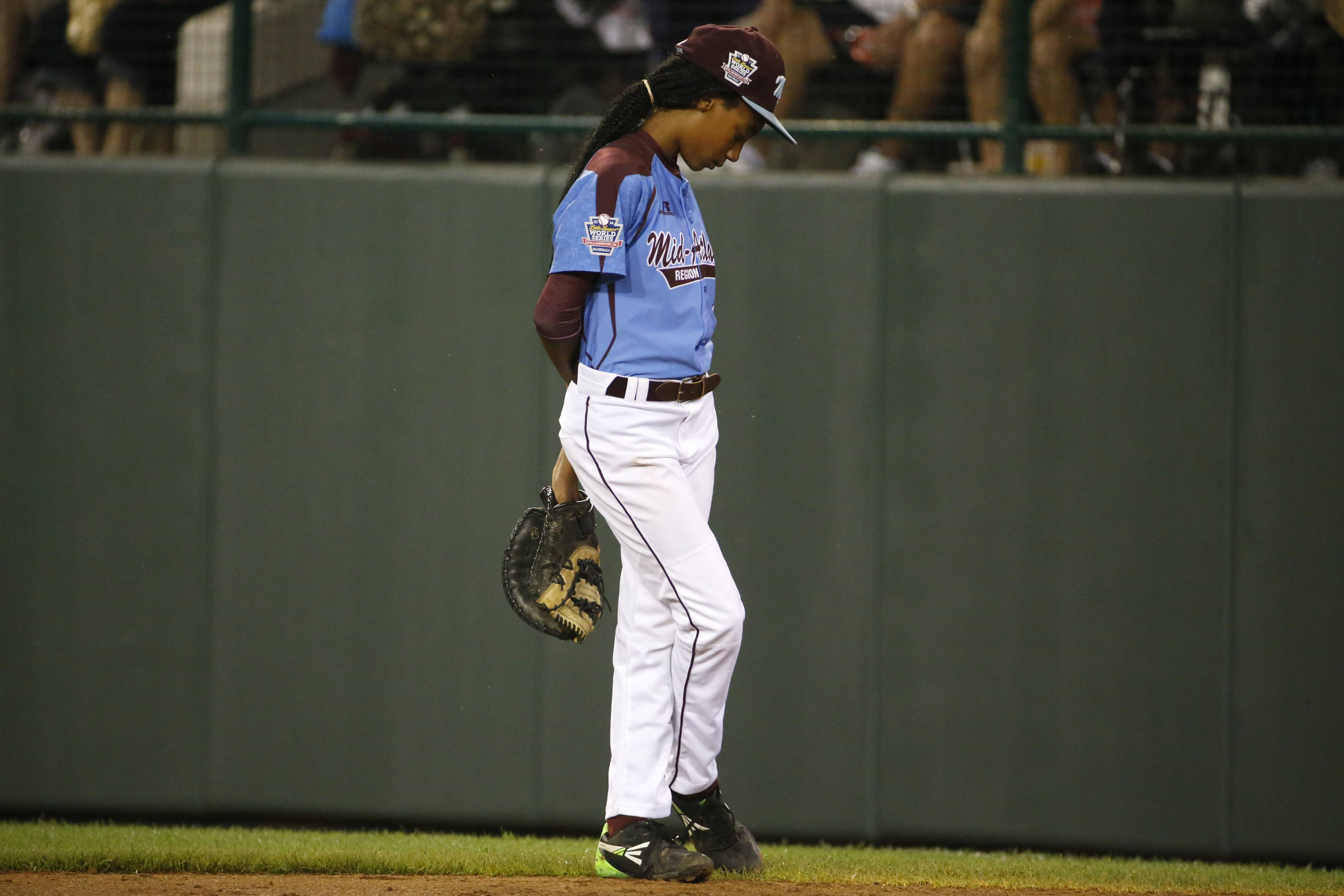 Philadelphia pitcher Mo'ne Davis stands at first base after being removed as pitcher in the third inning of a United States semi-final baseball game Wednesday against Las Vegas at the Little League World Series tournament in South Williamsport, Pa. Philly lost to the Vegas team 8-1.