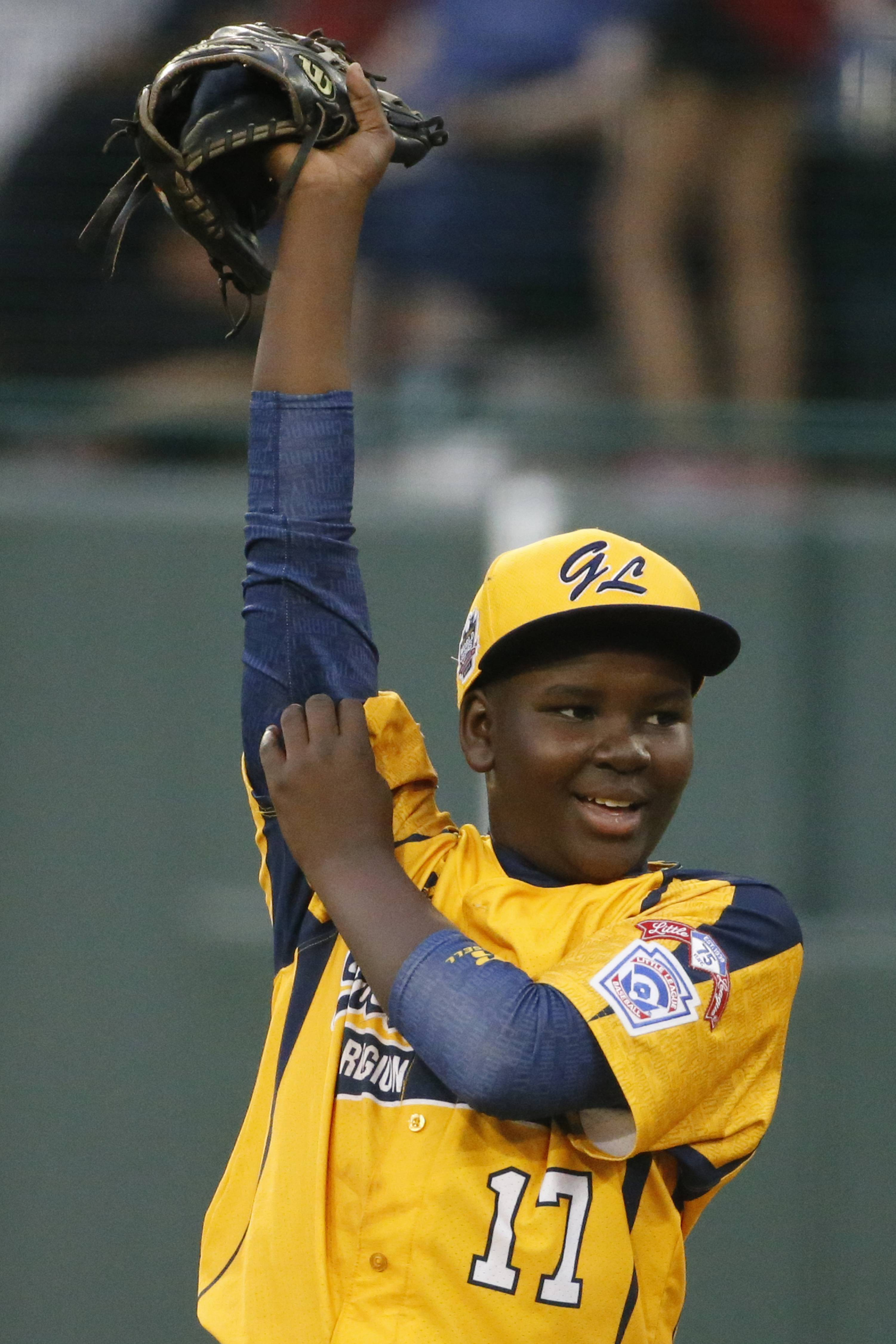 Chicago pitcher Joshua Houston helped his Jackie Robinson West team win an elimination game Tuesday at the Little League World Series in South Williamsport, Pa. Chicago beat Texas 6-1 and will play again on Thursday.