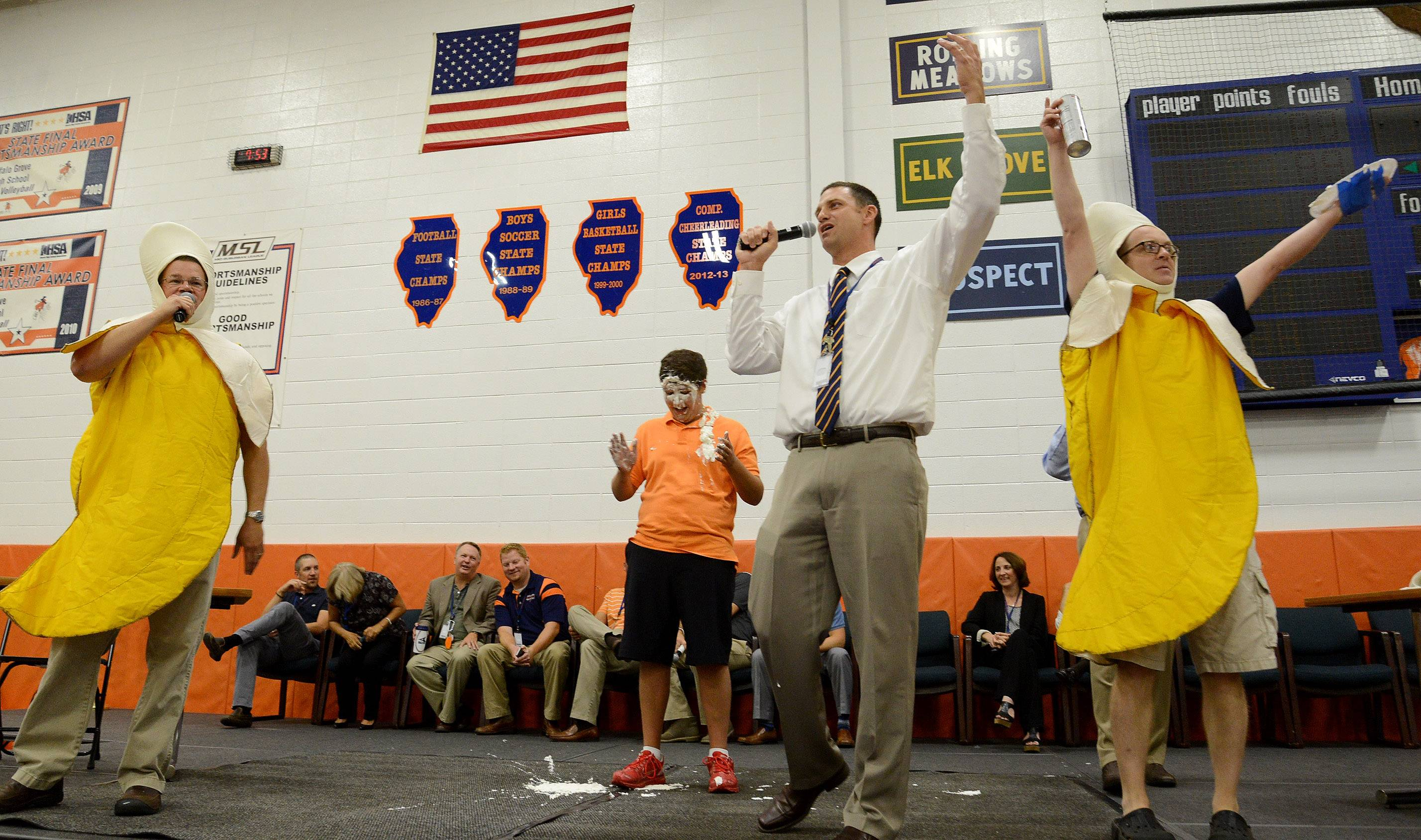 From left, Banana Man Tim Kosiek, senior class President Matt Shapiro, (who got a pie in the face from the Banana Men,) new Principal Jeff Wardle and Banana Man Rich Schram close out a back-to-school pep rally Wednesday at Buffalo Grove High School.