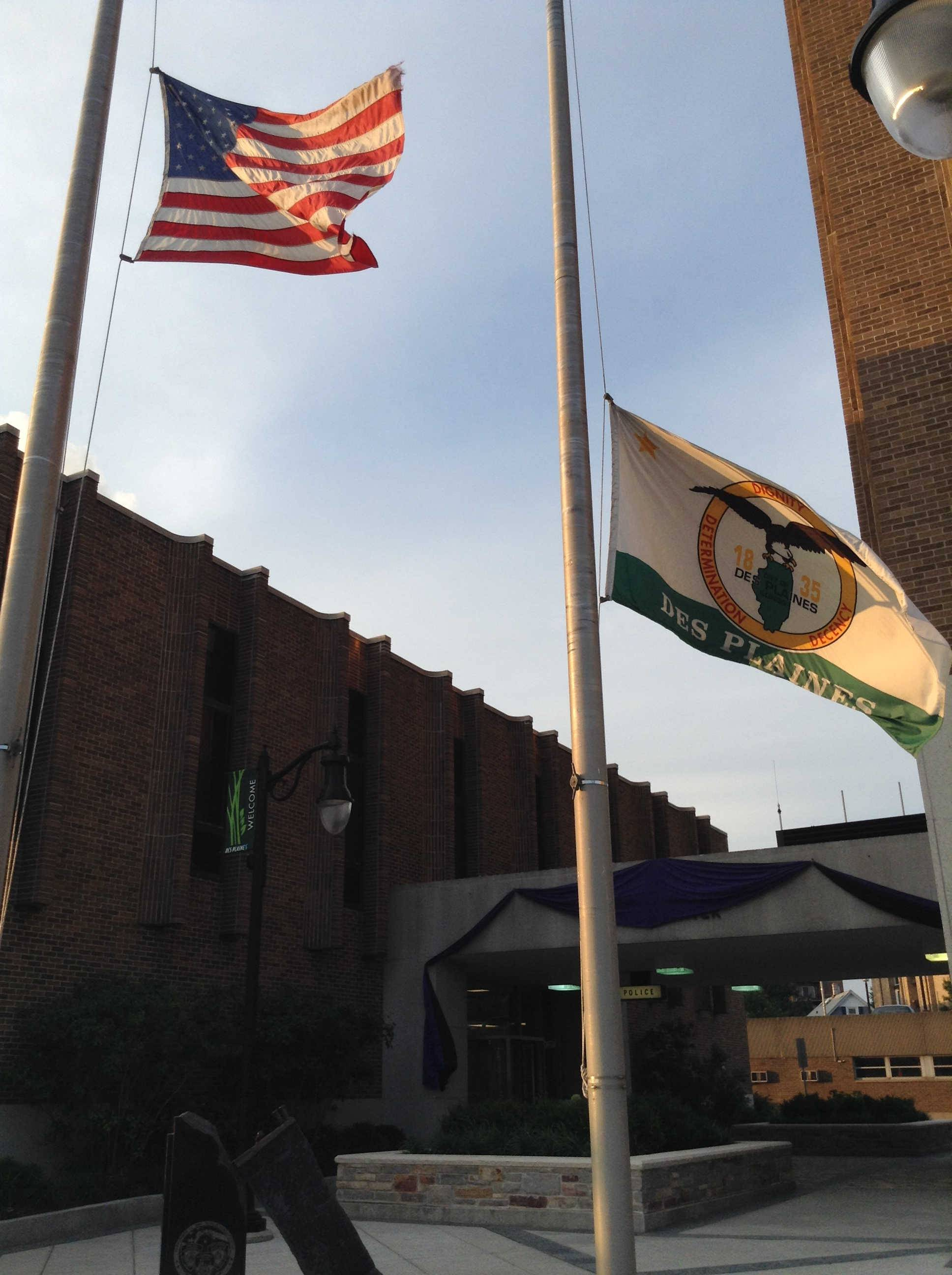 Flags fly at half-staff outside Des Plaines city hall Wednesday in honor of Alderman Joanna Sojka, who died late Monday of an apparent stroke.