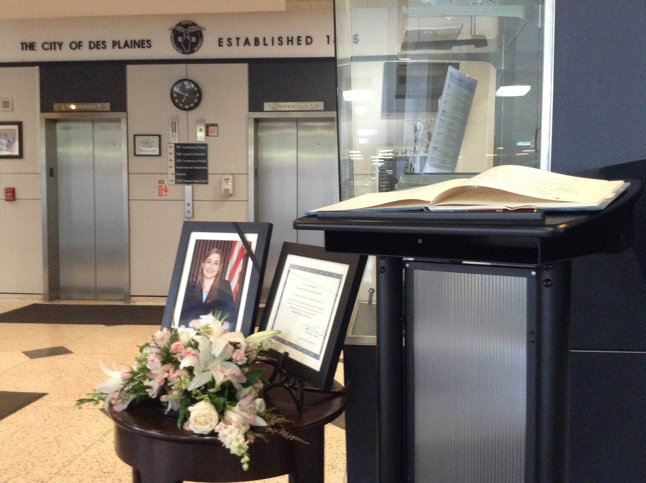 A book of condolences sits within the lobby of Des Plaines city hall following the death of 29-year-old Alderman Joanna Sojka.