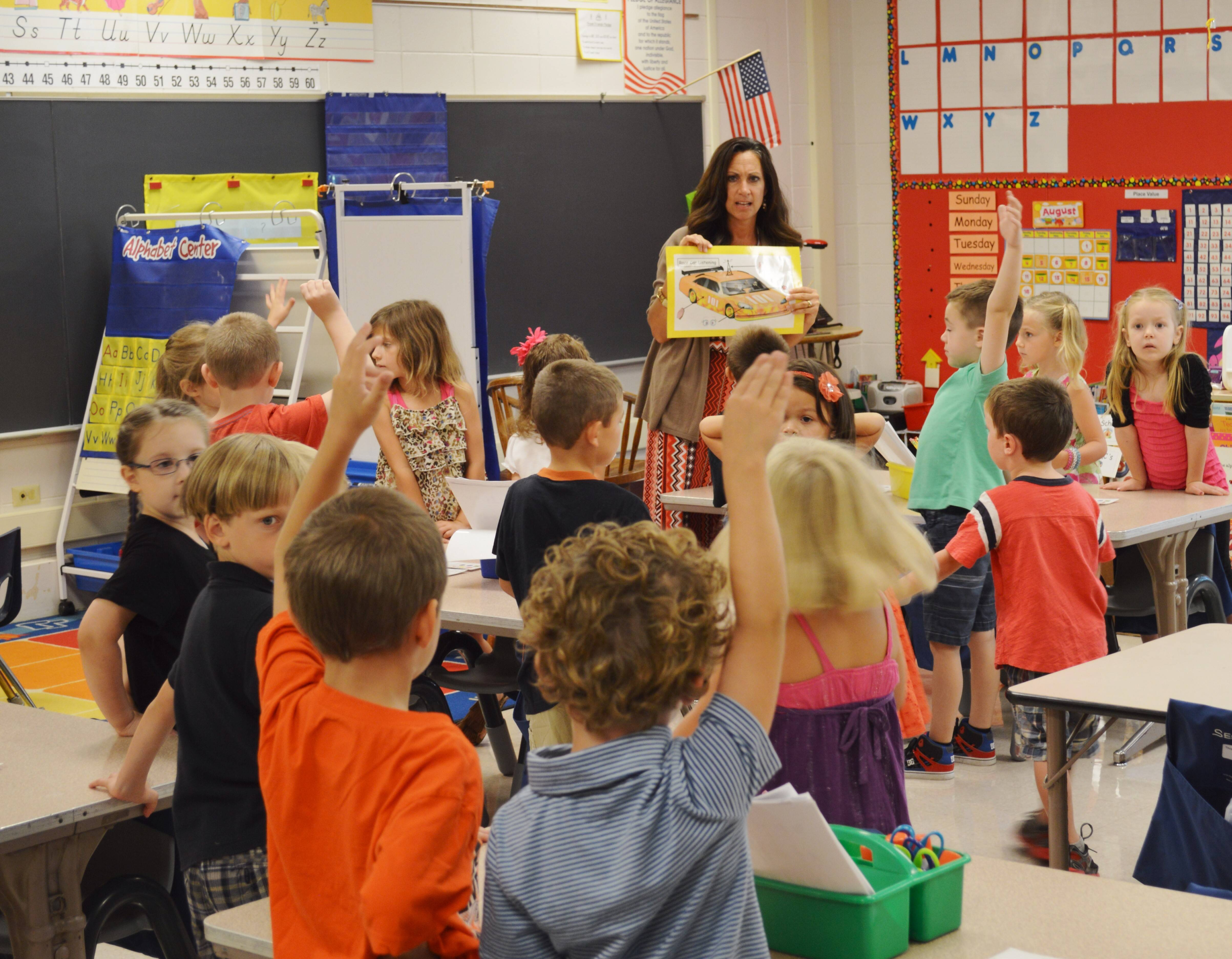 Munhall Elementary kindergarten teacher Amy Fronk started students Wednesday with a lesson on how to calmly and slowly maneuver their cars (meaning themselves) around the classroom without getting jammed up when it's time for a group sit-down.