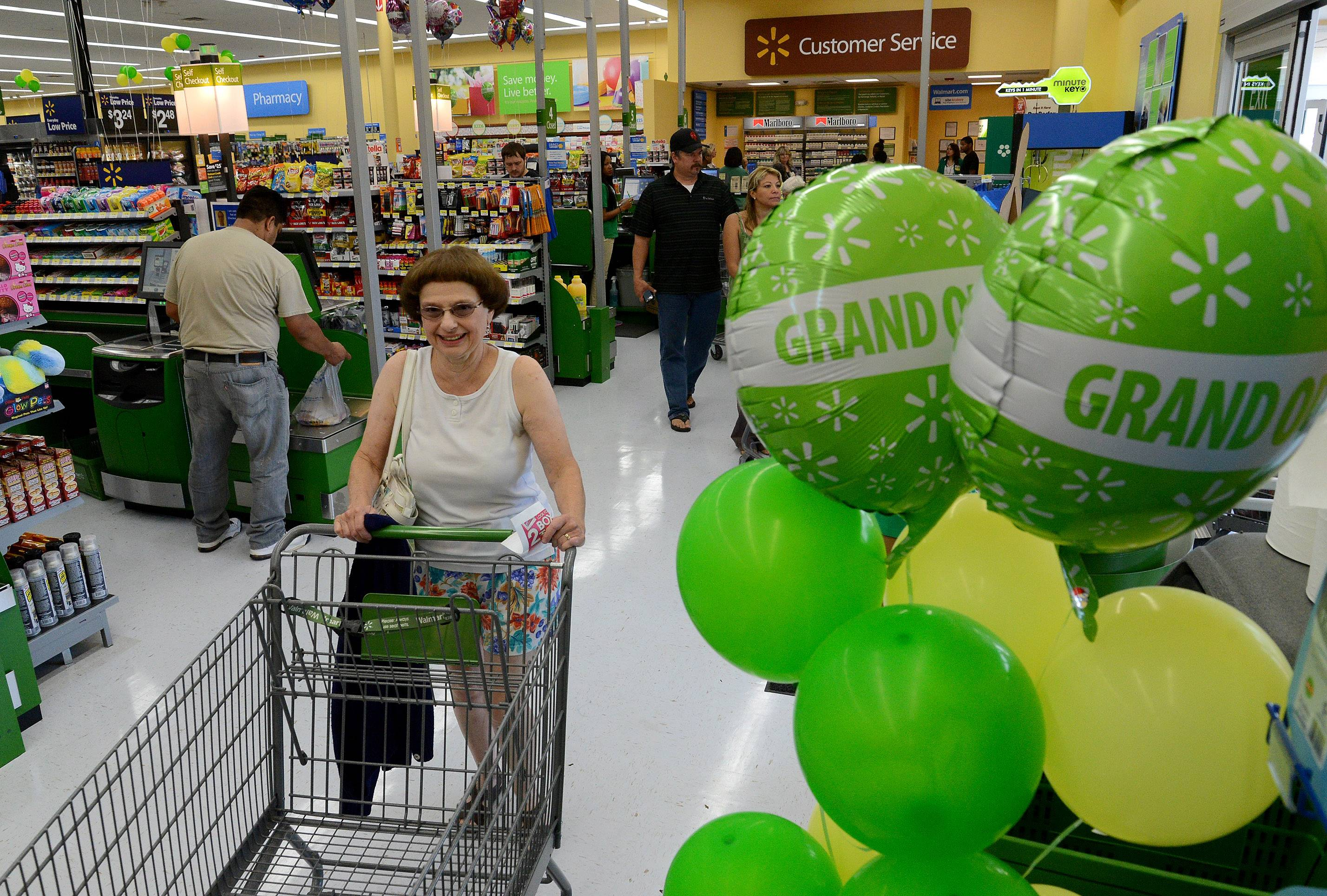 Sally Benson of Des Plaines begins shopping Wednesday on the first day of the Walmart Neighborhood Market in Des Plaines.