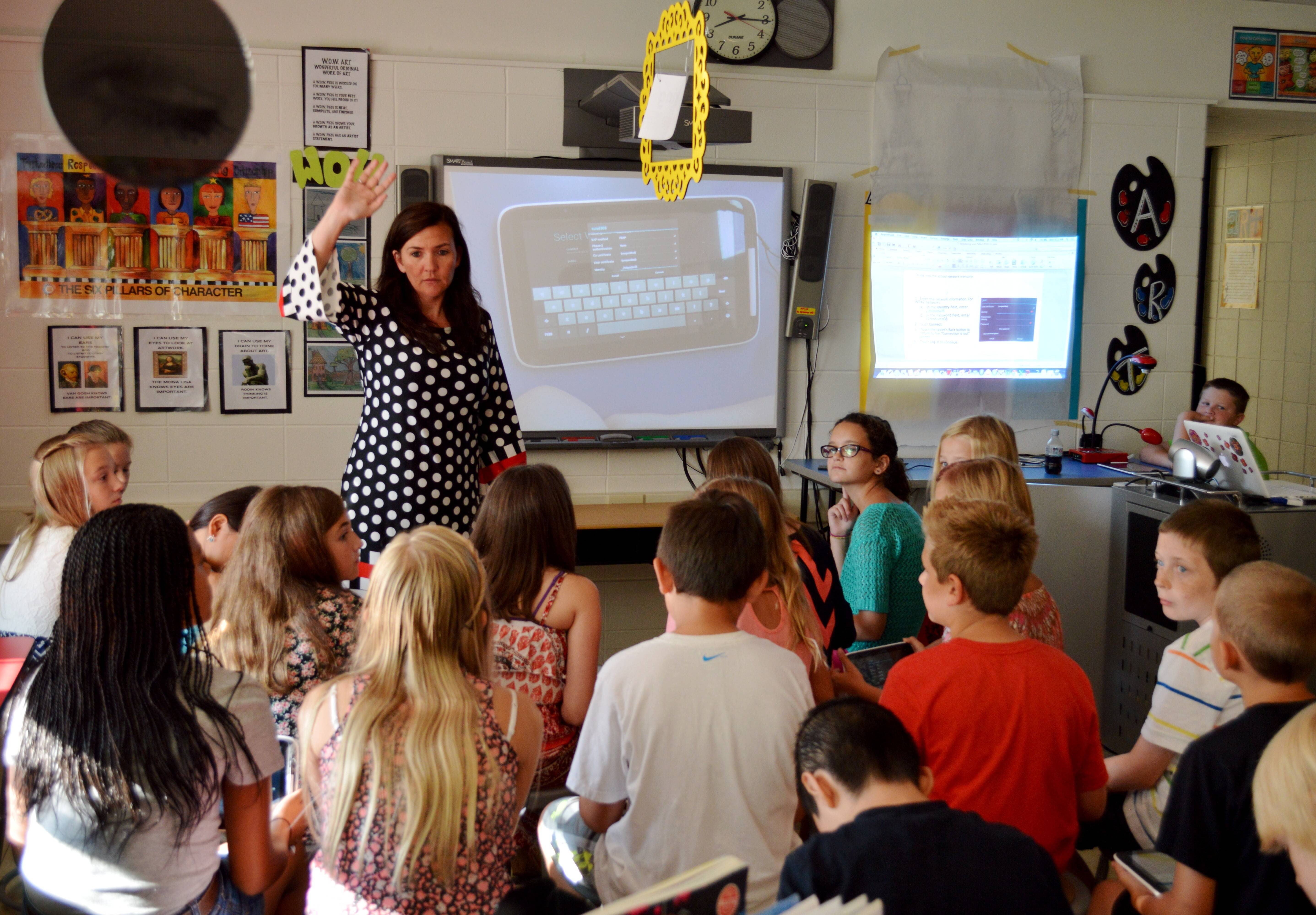 Richmond Intermediate Sci-Tech teacher Amy Dixon introduced students to a new piece of technology the St. Charles elementary schools are adopting this year. Each student at the school will receive a new tablet designed specifically for classroom use.