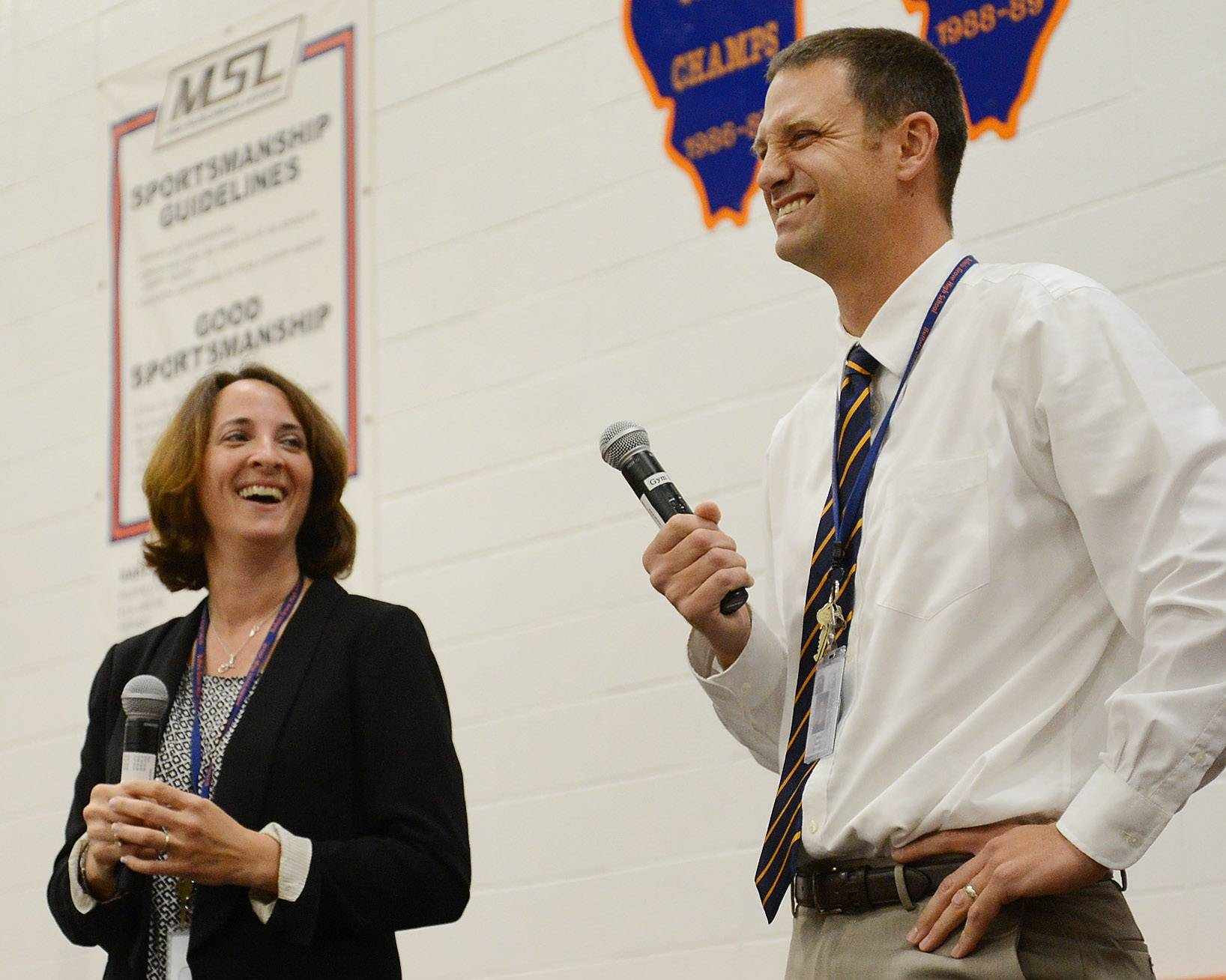 New Buffalo Grove High School principal Jeff Wardle and associate principal Jill Maraldo compete in a game show answering  questions about themselves and how much knowledge they have of Buffalo Grove High School, during a back to school pep-rally to kick off the first day of school.