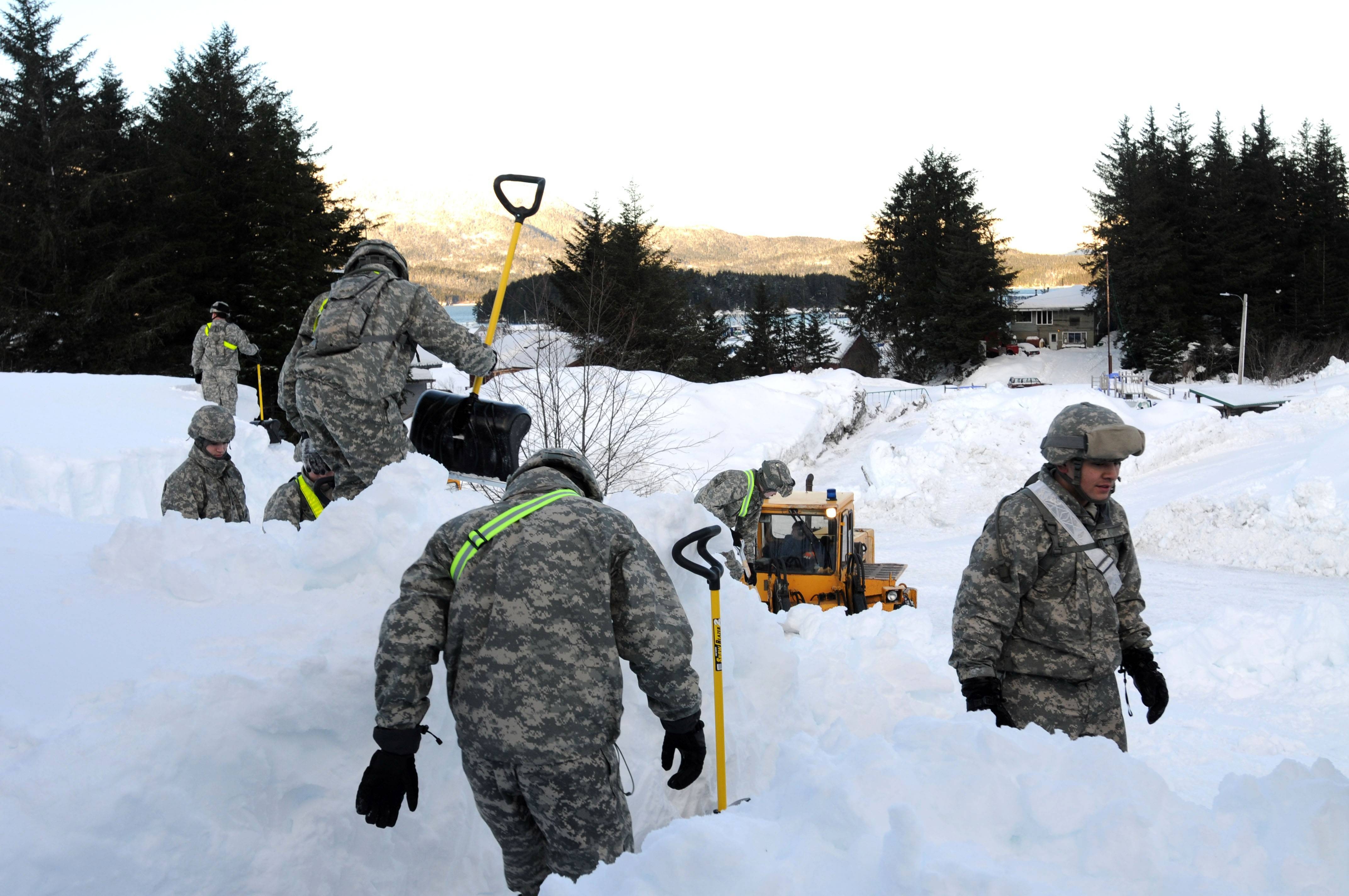 Members of the Alaska National Guard dig out the fishing town of Cordova in 2012 after massive snows in Alaska collapsed roofs, trapped some people in homes and triggered avalanches.