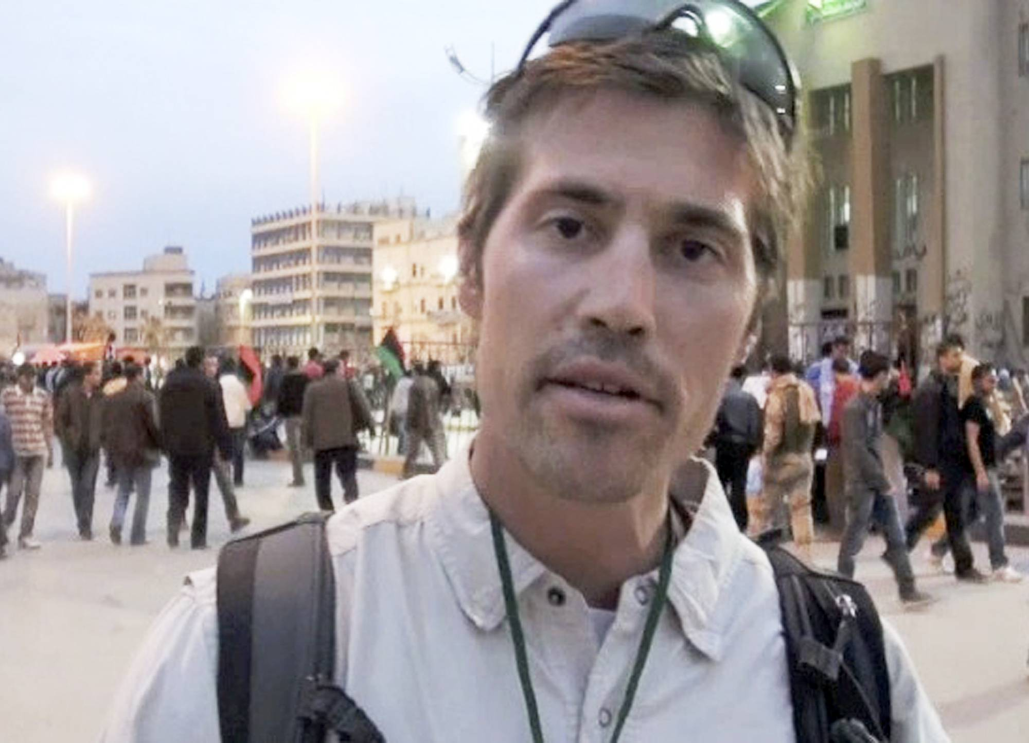 James Foley of Rochester, N.H., a freelance contributor for GlobalPost, is seen in Benghazi, Libya, April 7, 2011. In a horrifying act of revenge for U.S. airstrikes in northern Iraq, militants with the Islamic State extremist group beheaded Foley -- and are threatening to kill another hostage, U.S. officials say.