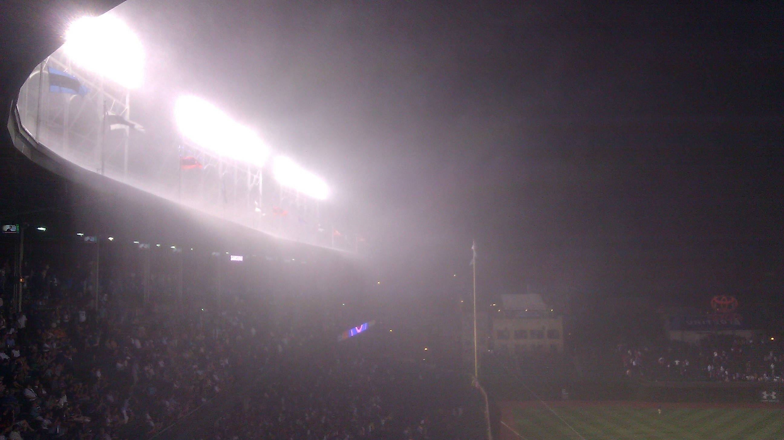 The heavy rain didn't last very long last night at Wrigley Field, but it was long enough to drench the field not covered by an unsuspecting umpire and grounds crew, so the delay lasted past 1:15 a.m.