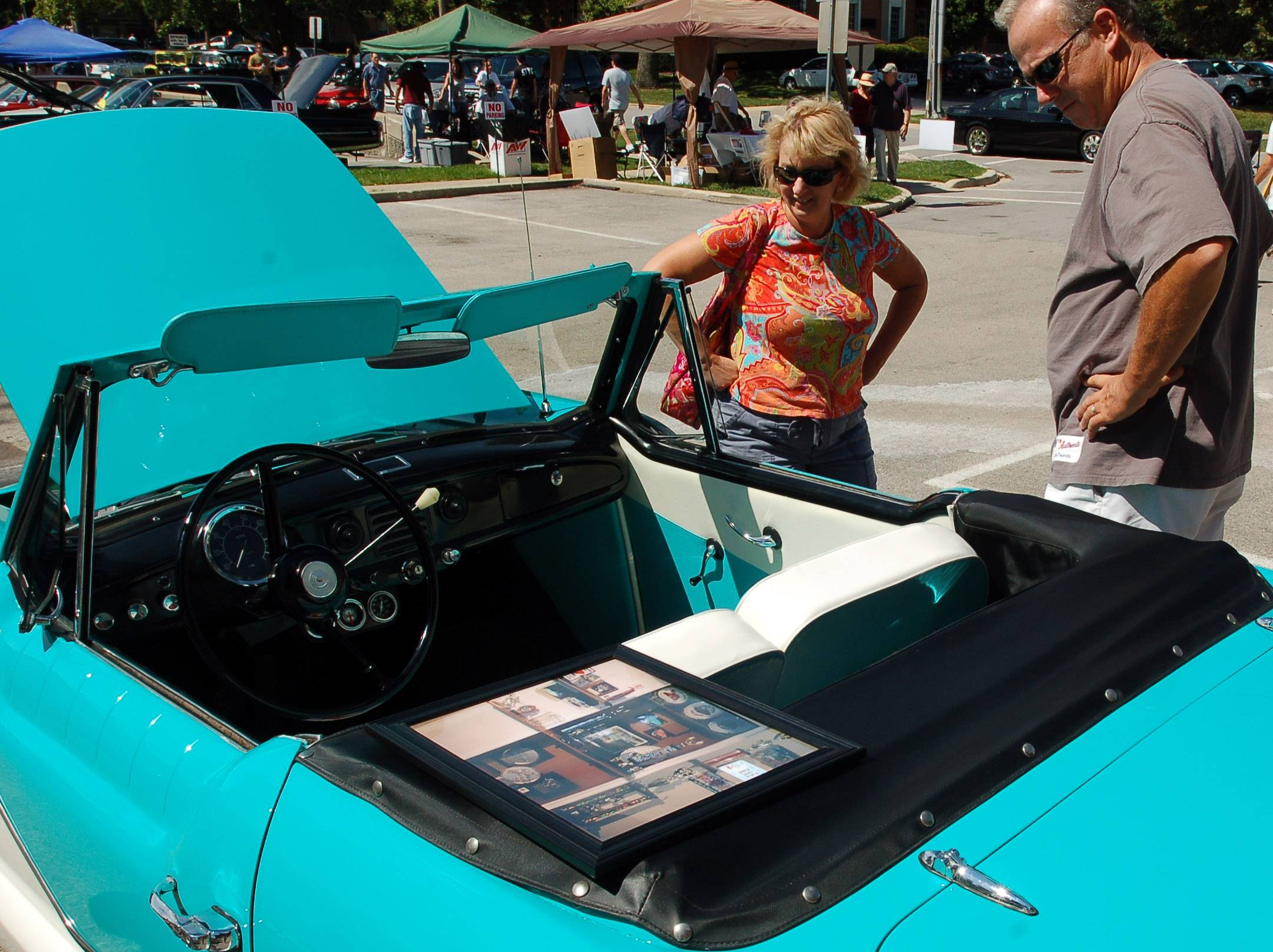 Bob and Jennifer St. Mary of Batavia check out a car on display at a previous Geneva Concours d'Elegance car show.