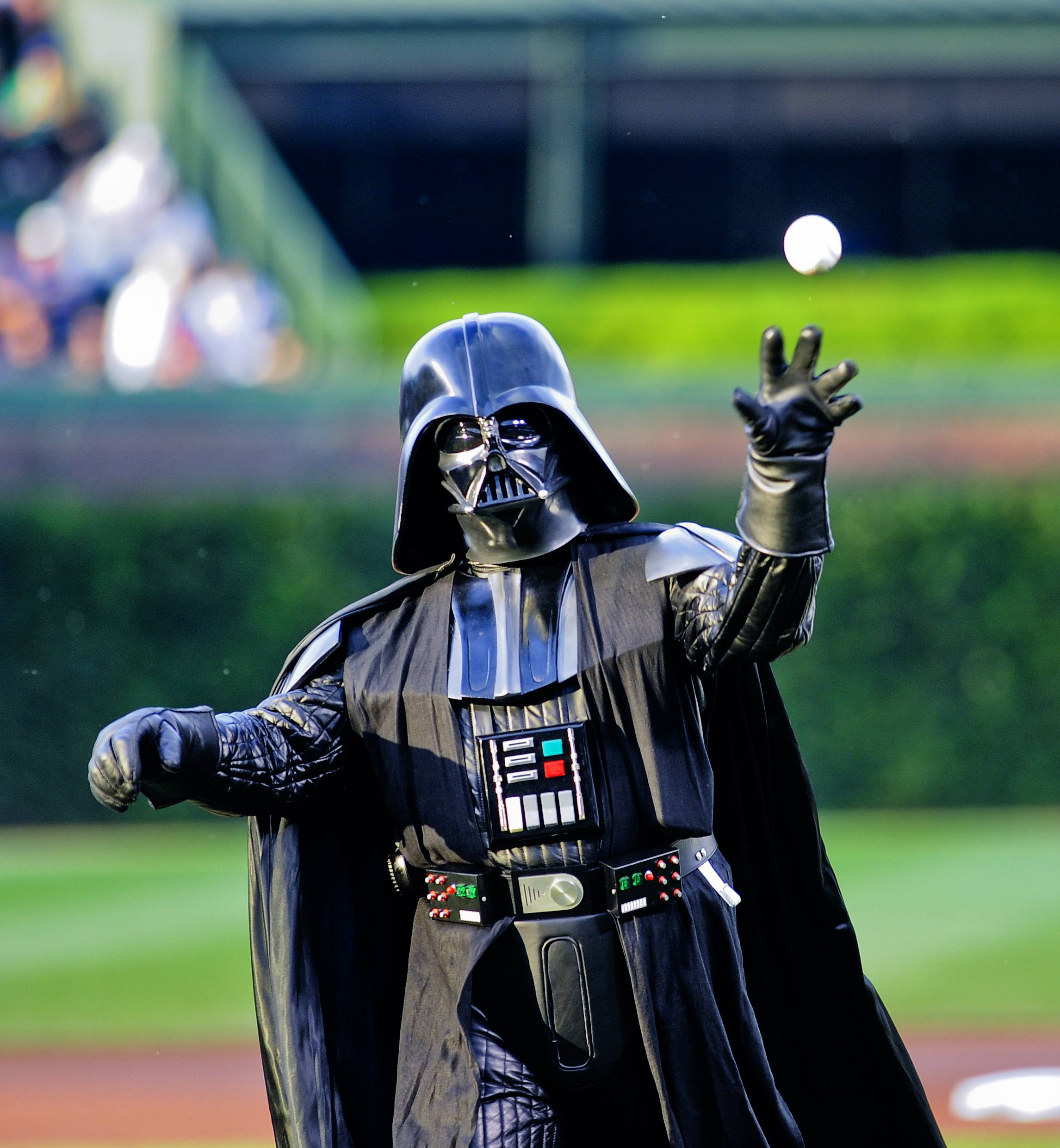Darth Vader throws out a ceremonial first pitch before the start of a baseball game between the San Francisco Giants and the Chicago Cubs on Wednesday in Chicago.
