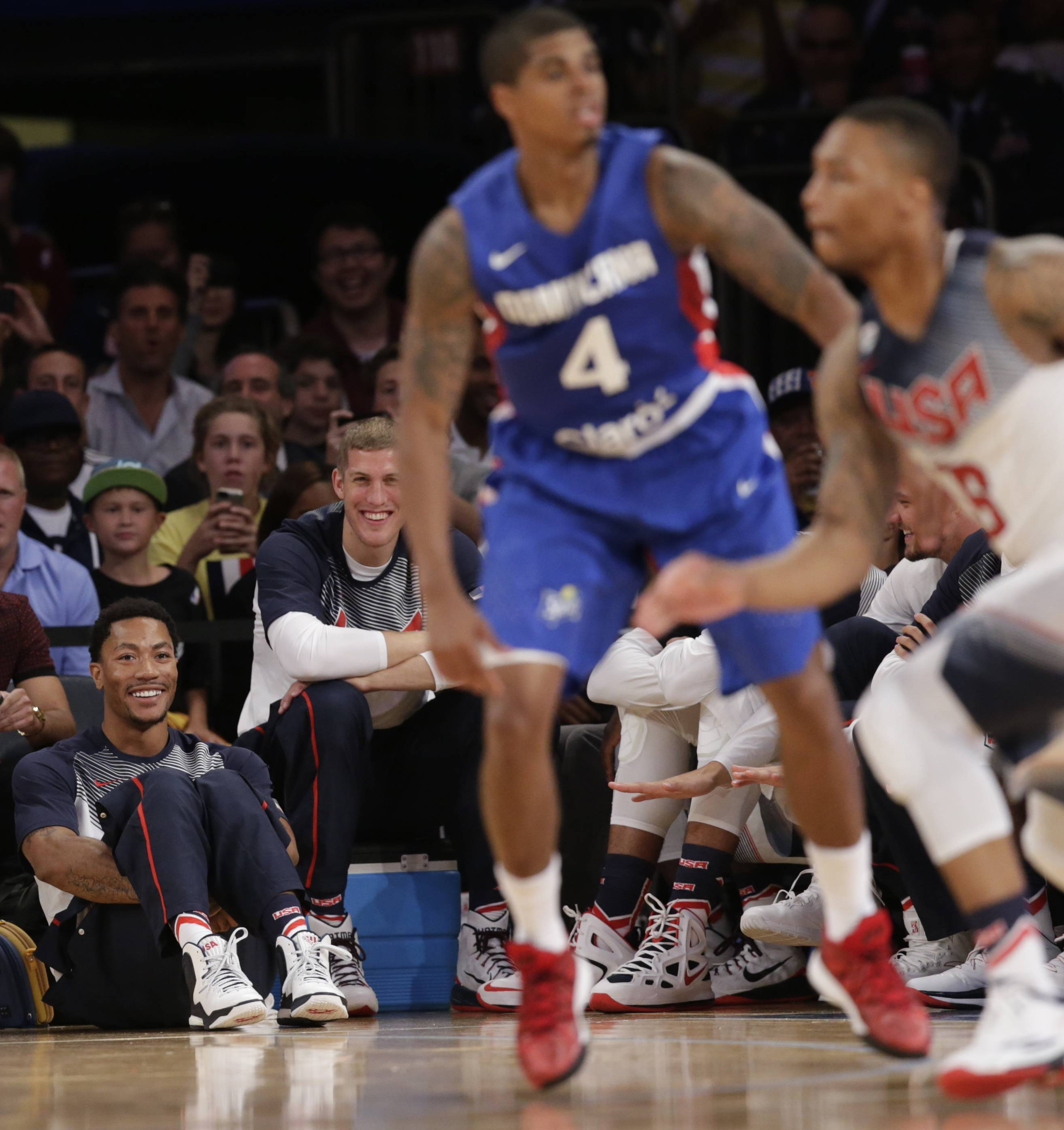 U.S. guard Derrick Rose, lower left, and forward Mason Plumlee, next to Rose, watch the second half of an exhibition basketball game Wednesday between the United States and the Dominican Republic at Madison Square Garden in New York. The U.S. team won 105-62.
