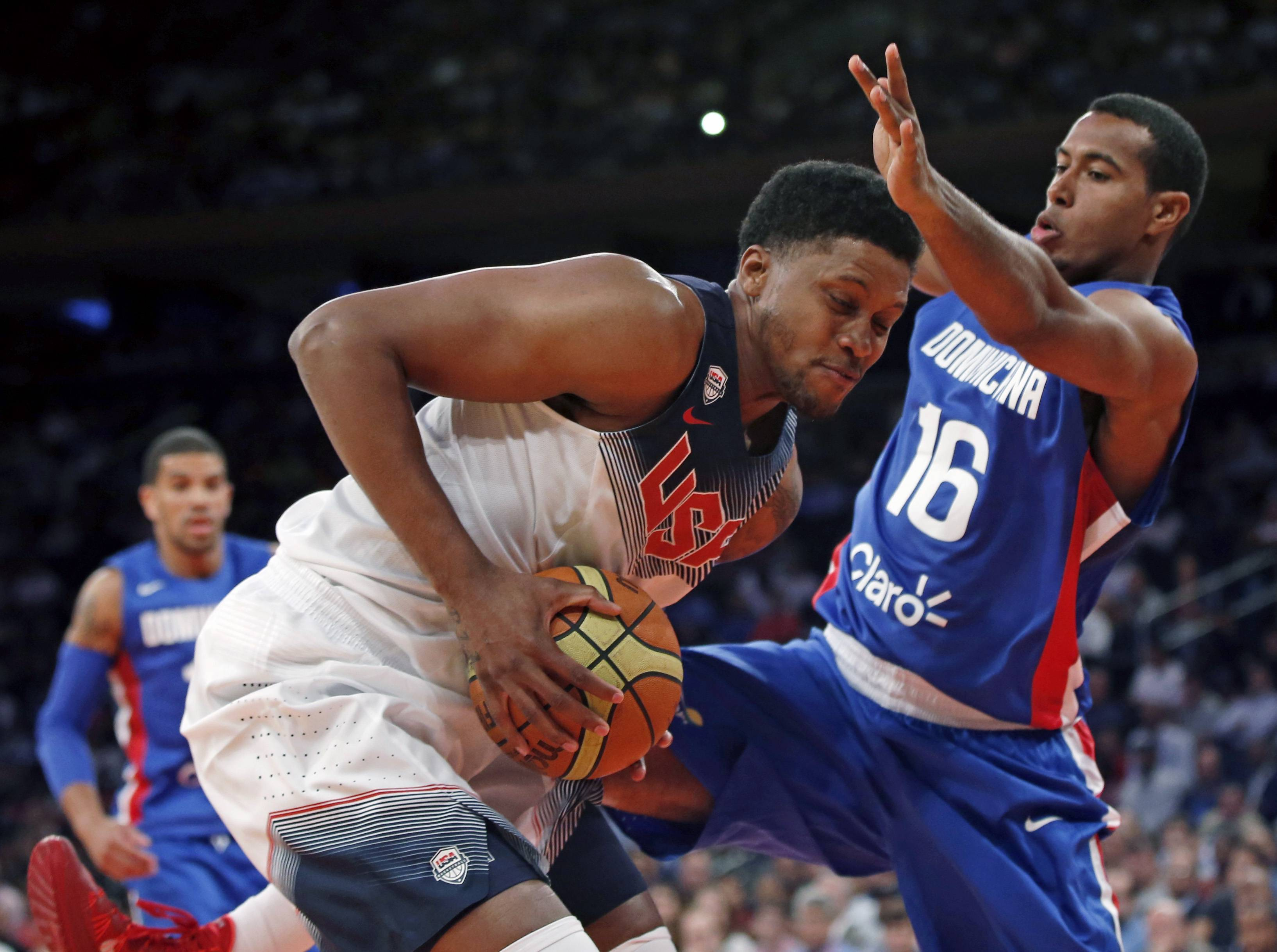 Dominican Republic forward Orlando Sanchez (16) defends as U.S. forward Rudy Gay protects the ball during the first half of an exhibition basketball game Wednesday at Madison Square Garden in New York. The United States won 105-62.