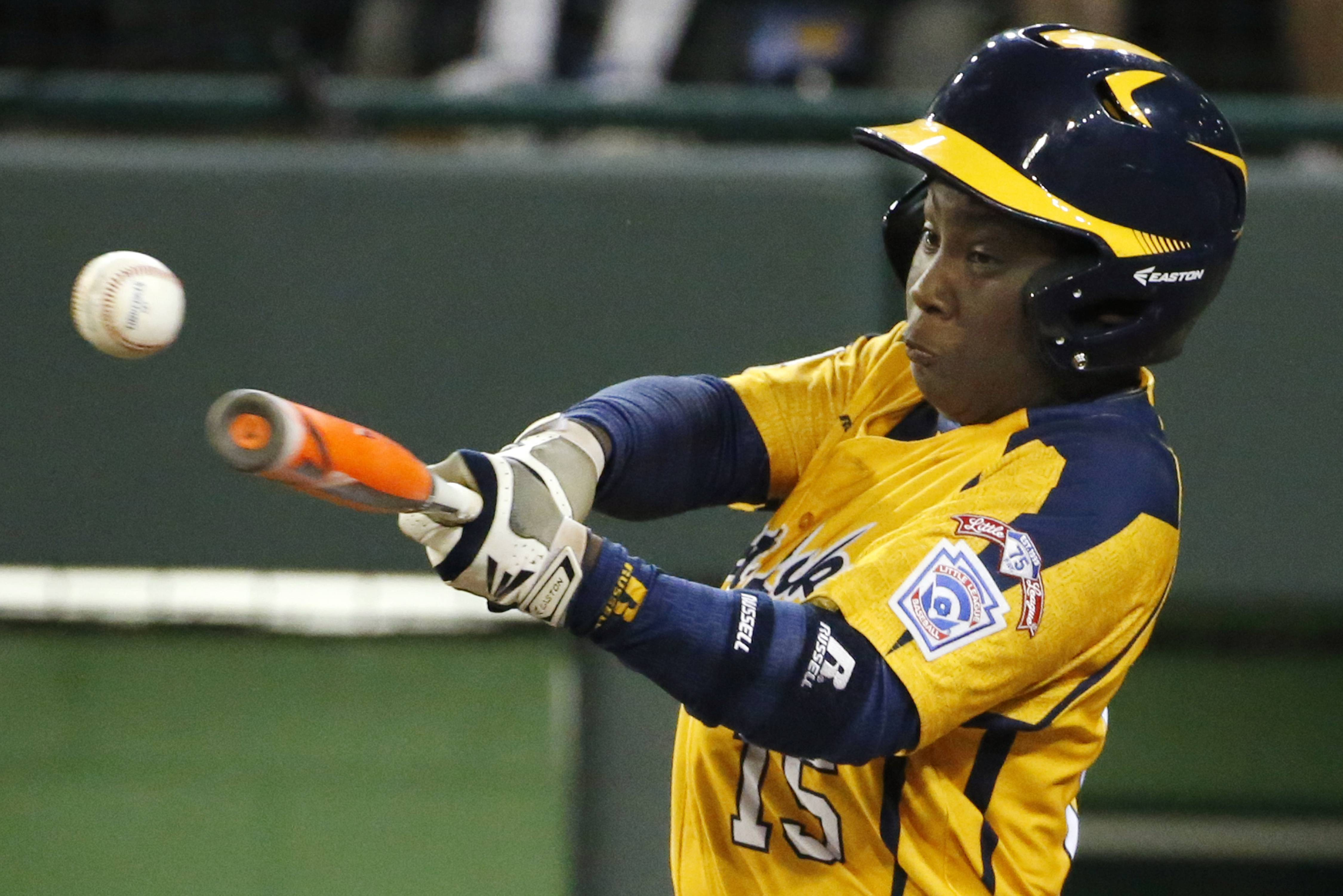 Chicago's Darion Radcliff (15) drives in a run with a single off in the fourth inning to help his Jackie Robinson West team win an elimination game Tuesday at the Little League World Series in South Williamsport, Pa. Chicago beat Texas 6-1 and will play again on Thursday.