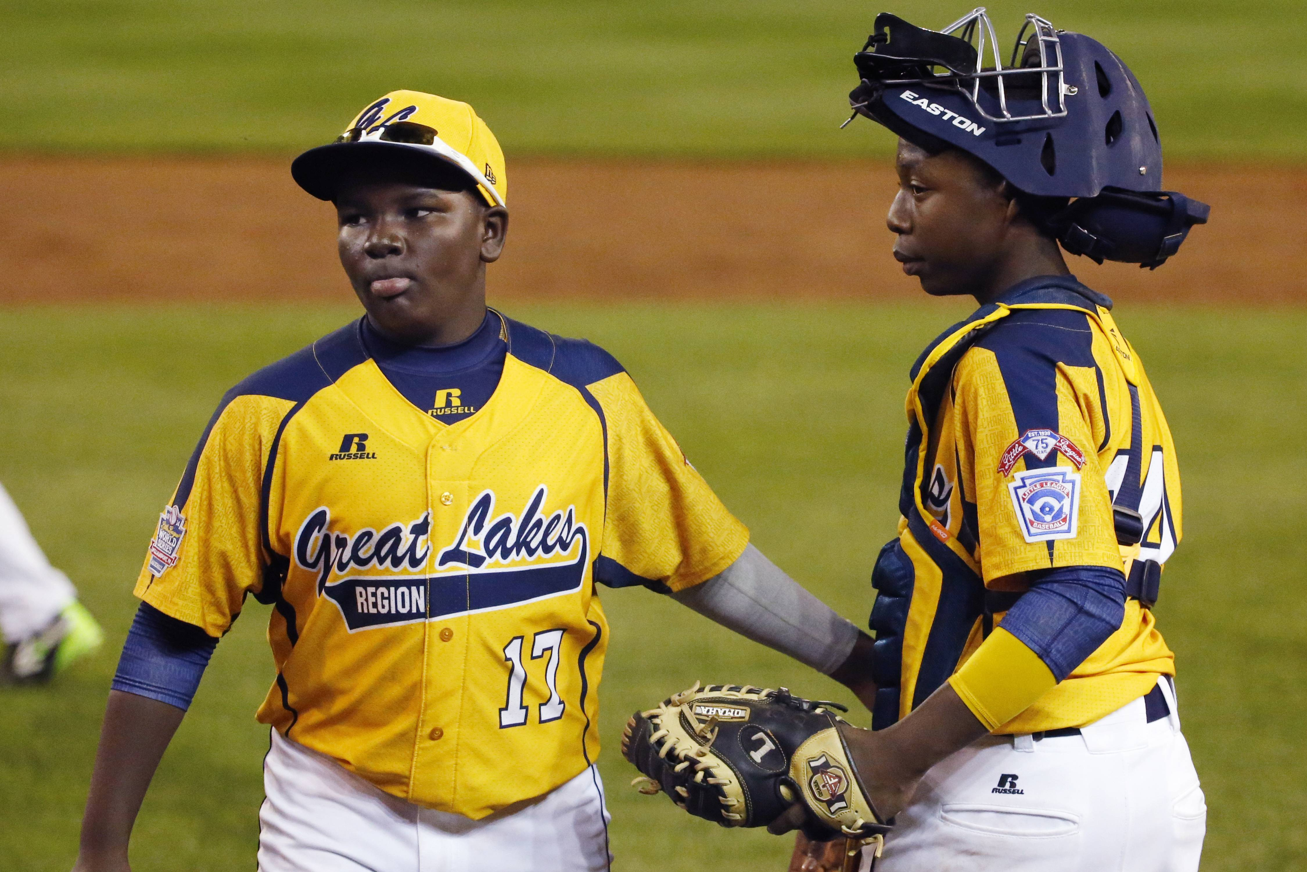 Chicago's Joshua Houston (17) and catcher Brandon Green gather their Jackie Robinson West team after winning an elimination game Tuesday at the Little League World Series in South Williamsport, Pa. Chicago beat Texas 6-1 and will play again on Thursday.