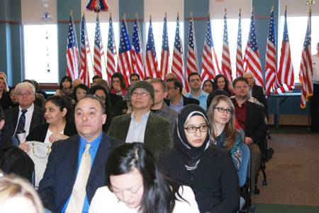 Immigrants wait to receive their U.S. Naturalization certificate at the Schaumburg Township District Library. Taking citizenship classes at the library prepares people for their citizenship test and interview.Susan Miura