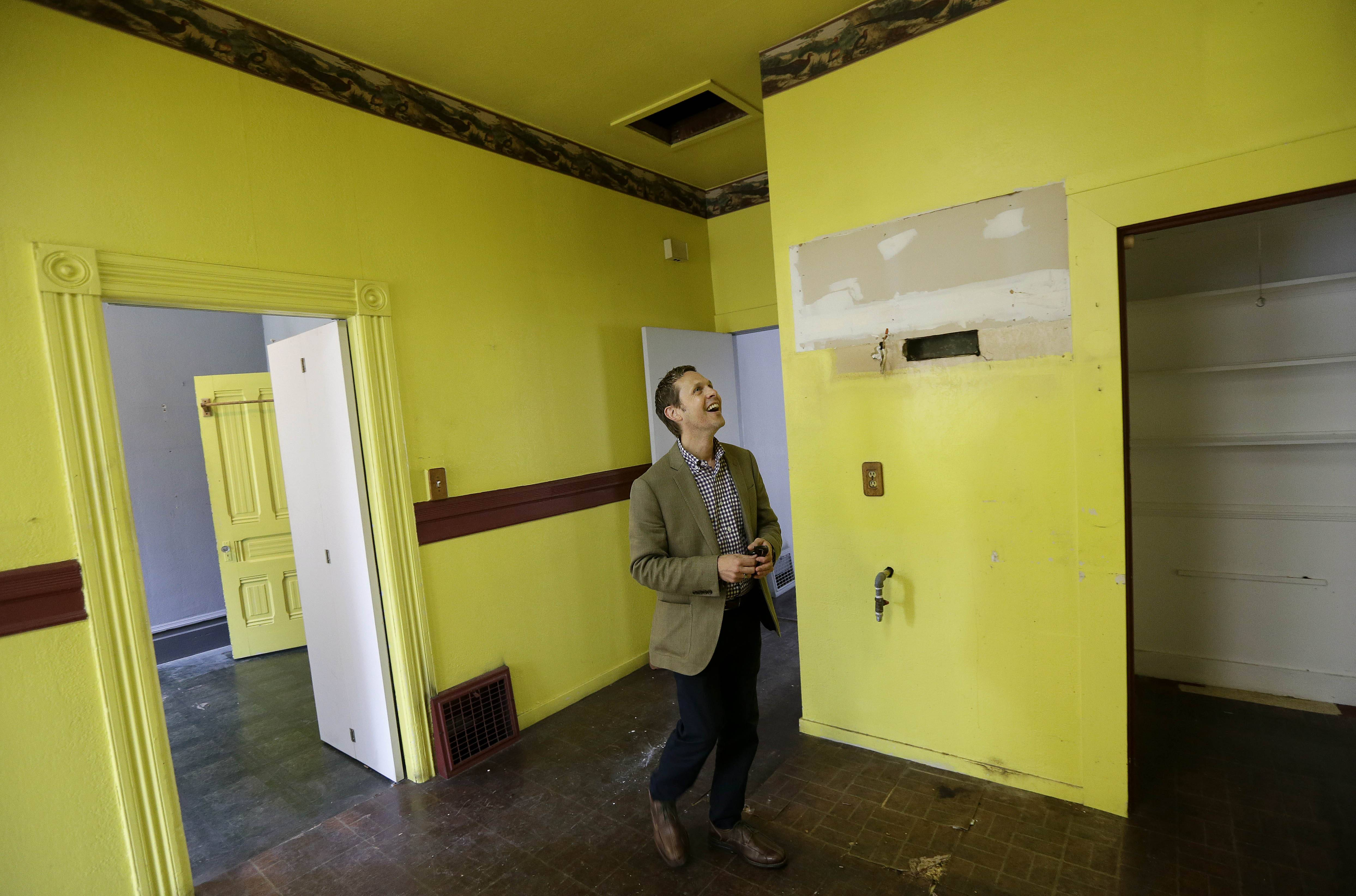 George Limperis, a realtor with Paragon Real Estate Group, walks through the kitchen of a property in the Noe Valley neighborhood in San Francisco. Purchases of previously owned U.S. homes unexpectedly rose in July to a 10-month high as low borrowing costs and an increase in inventory drew buyers.
