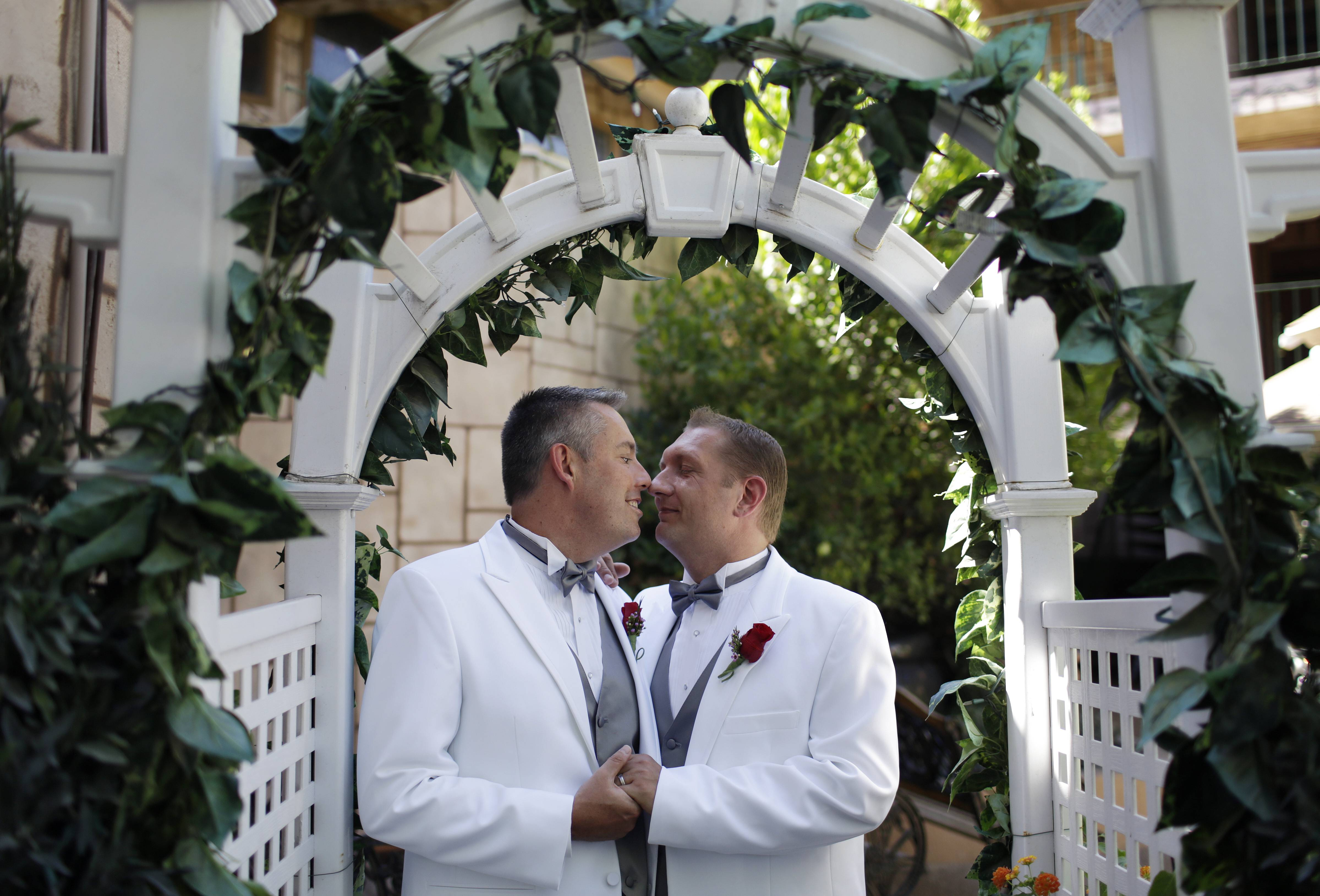 Scott McCann, left, and Jeremy Gilson of Nashua, N.H. have their commitment ceremony photos taken at the Viva Las Vegas Wedding Chapel in Las Vegas.