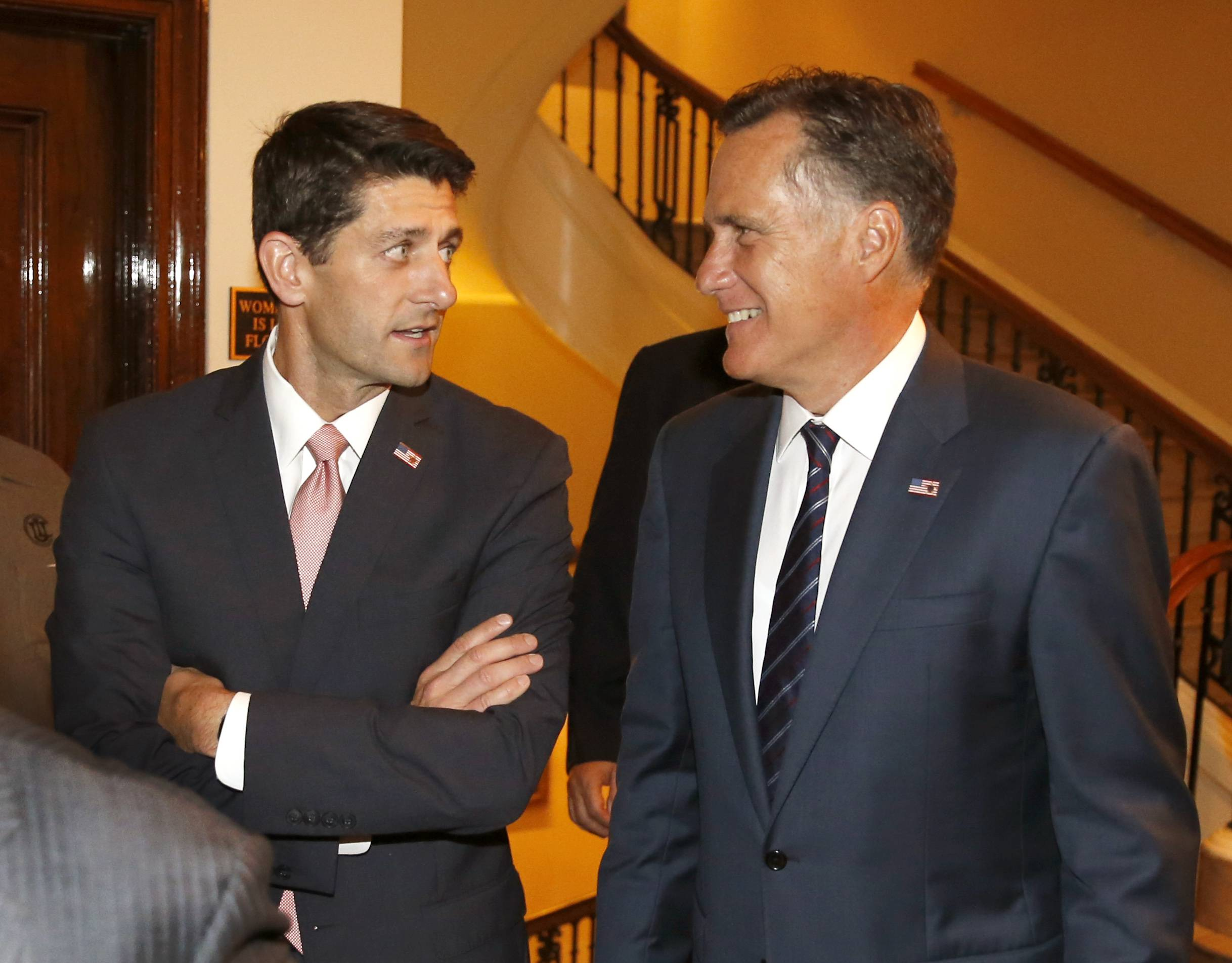 Massachusetts Gov. Mitt Romney, right and his former vice presidential running mate, U.S. Rep. Paul Ryan, arrive for a dinner Thursday at the Union League Club in Chicago.