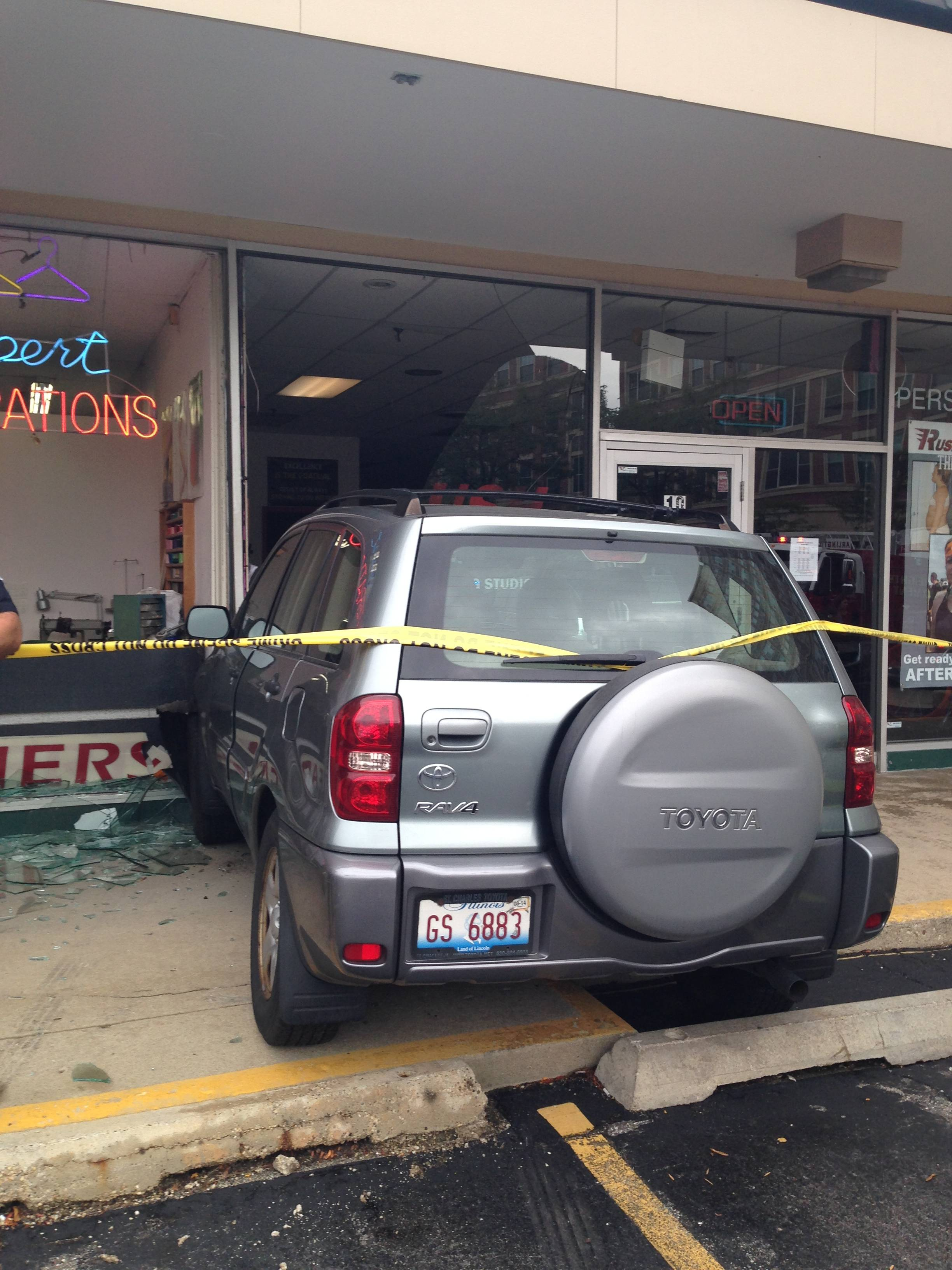 A sport utility vehicle struck two storefronts Thursday in the Evergreen Plaza shopping center in downtown Arlington Heights.