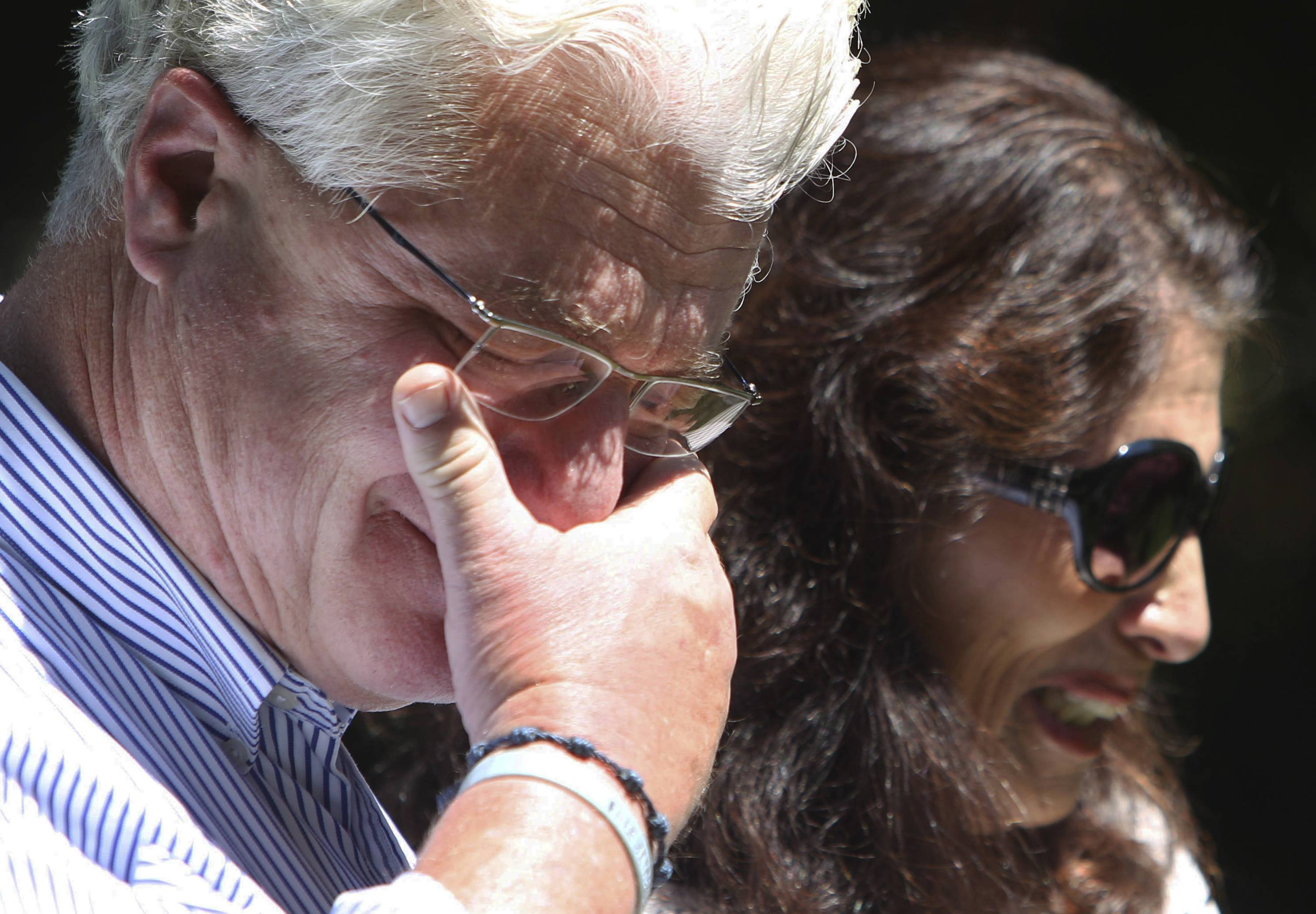 After speaking with U.S. President Barack Obama by phone, John and Diane Foley talk to reporters Wednesday outside their home in Rochester, N.H. Their son James Foley was abducted in November 2012 while covering the Syrian conflict. Islamic militants posted a video showing his murder on Tuesday.