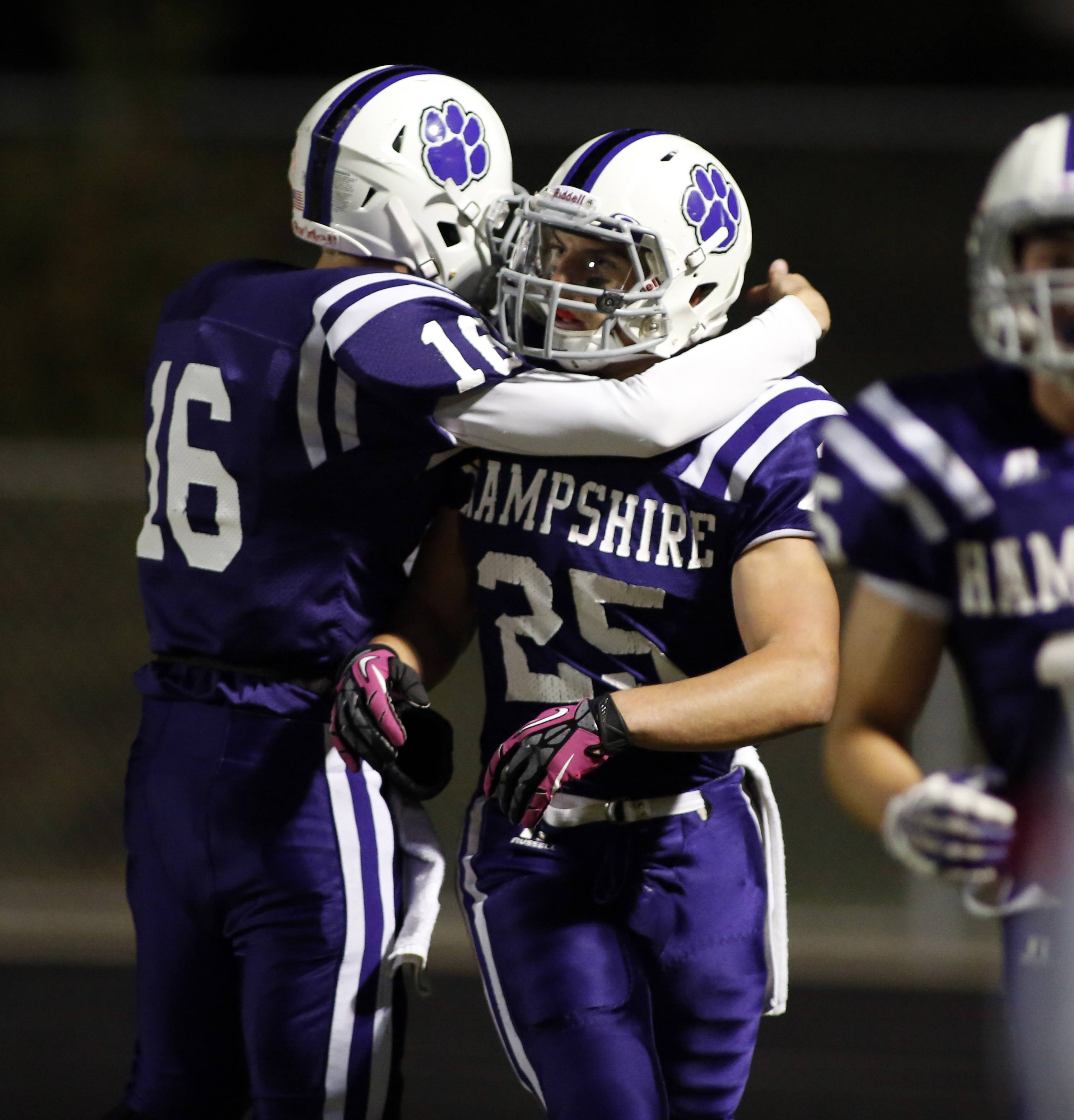 Hampshire's Nick Mohlman greets Nick Kielbasa after a touchdown last season.