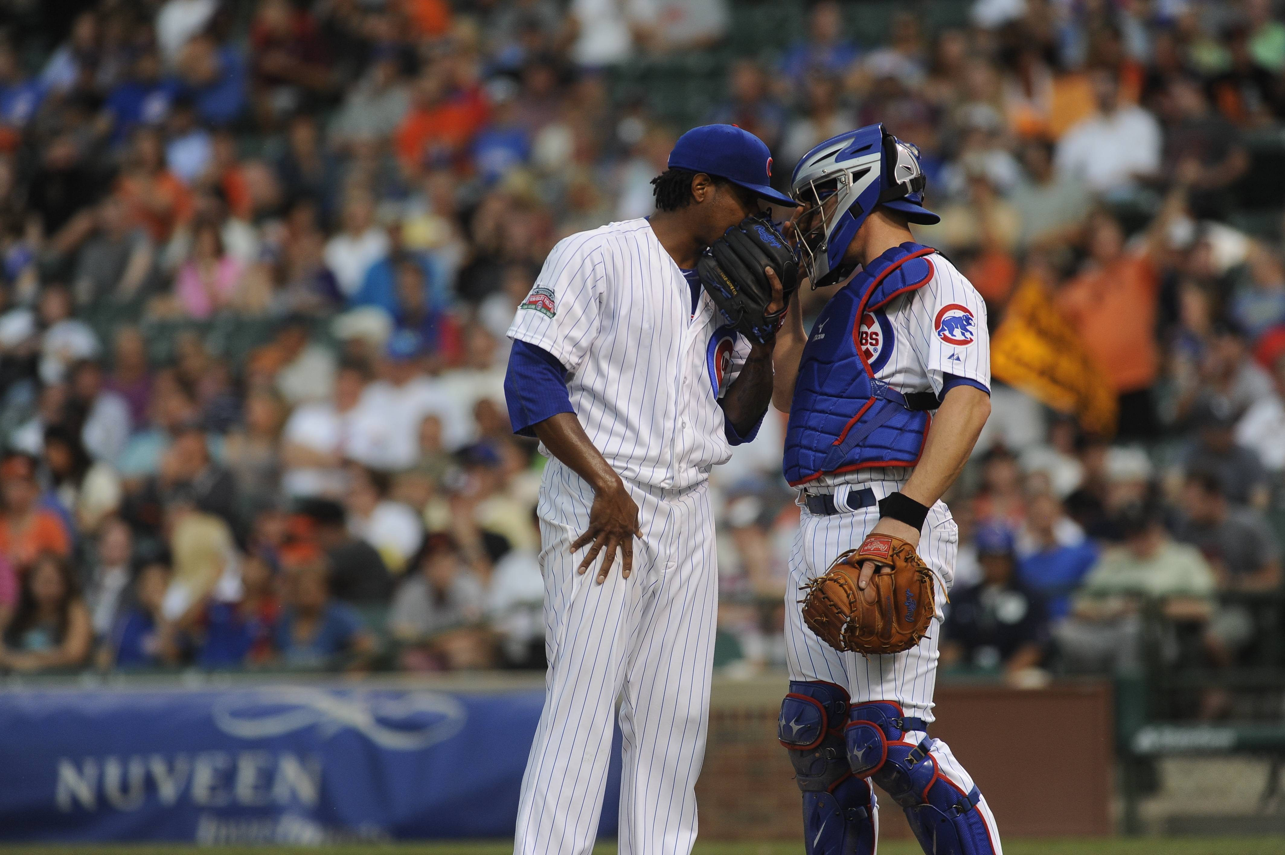 Chicago Cubs starting pitcher Edwin Jackson and Chicago Cubs catcher John Baker in a baseball game against the San Francisco Giants on Wednesday, Aug. 20, 2014, in Chicago. (AP Photo/Matt Marton)