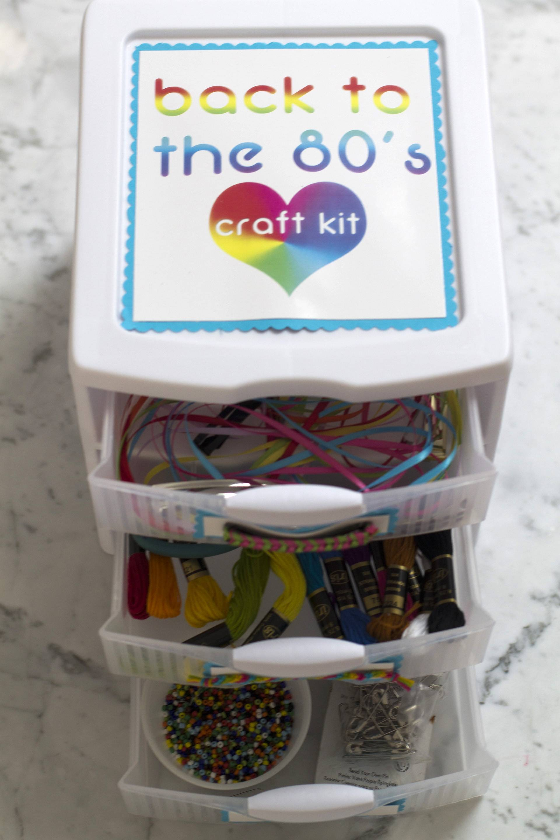 Here's a fun gift: a homemade kit filled with supplies to make girlie accessories from the 1980s: ribbon barrettes, friendship bracelets and friendship pins.