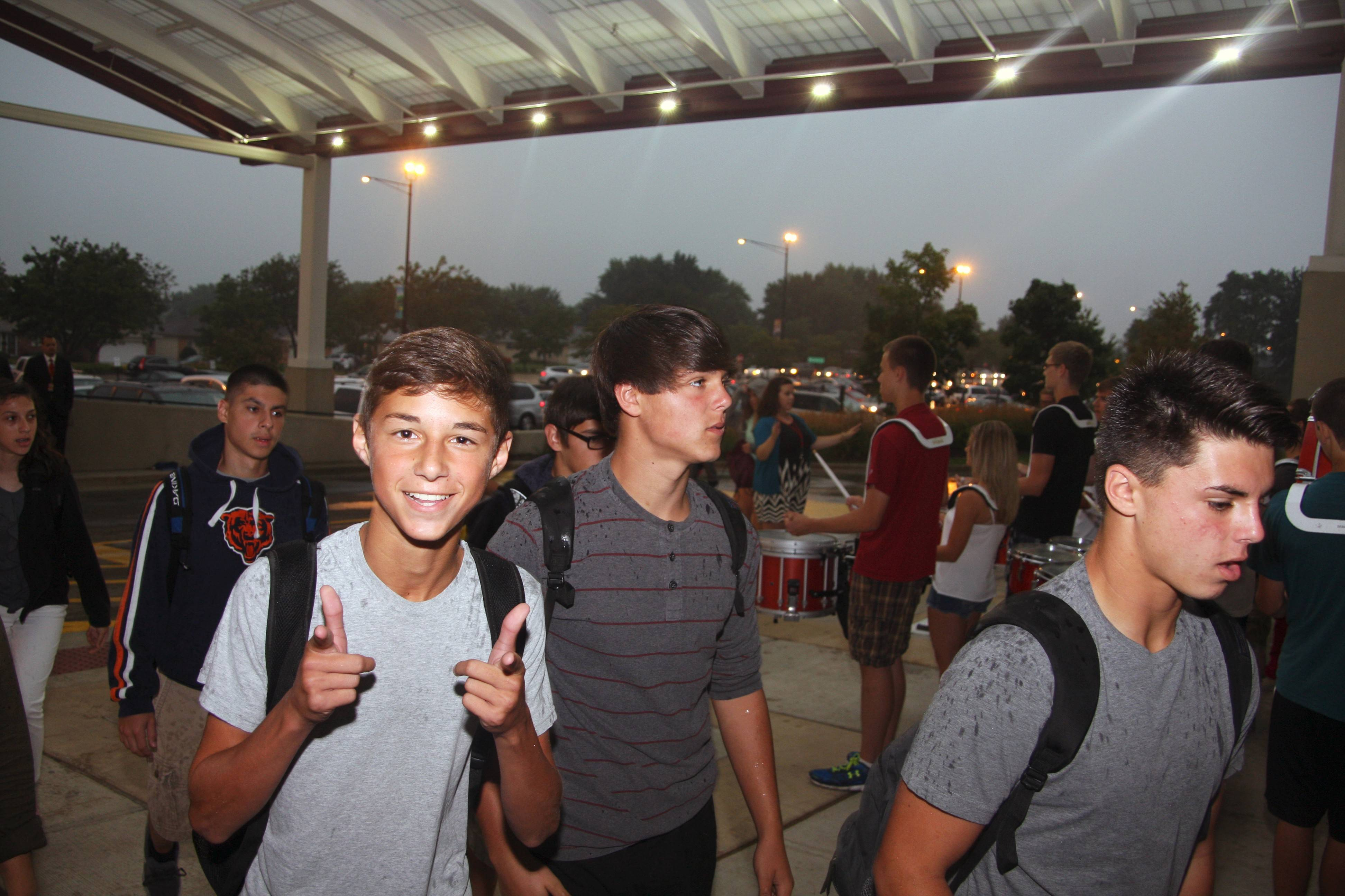 Schaumburg High School freshman Alec Greenhold started the new school year with two thumbs up as he enters next to sophomores Michael and Austin Anzelmo.
