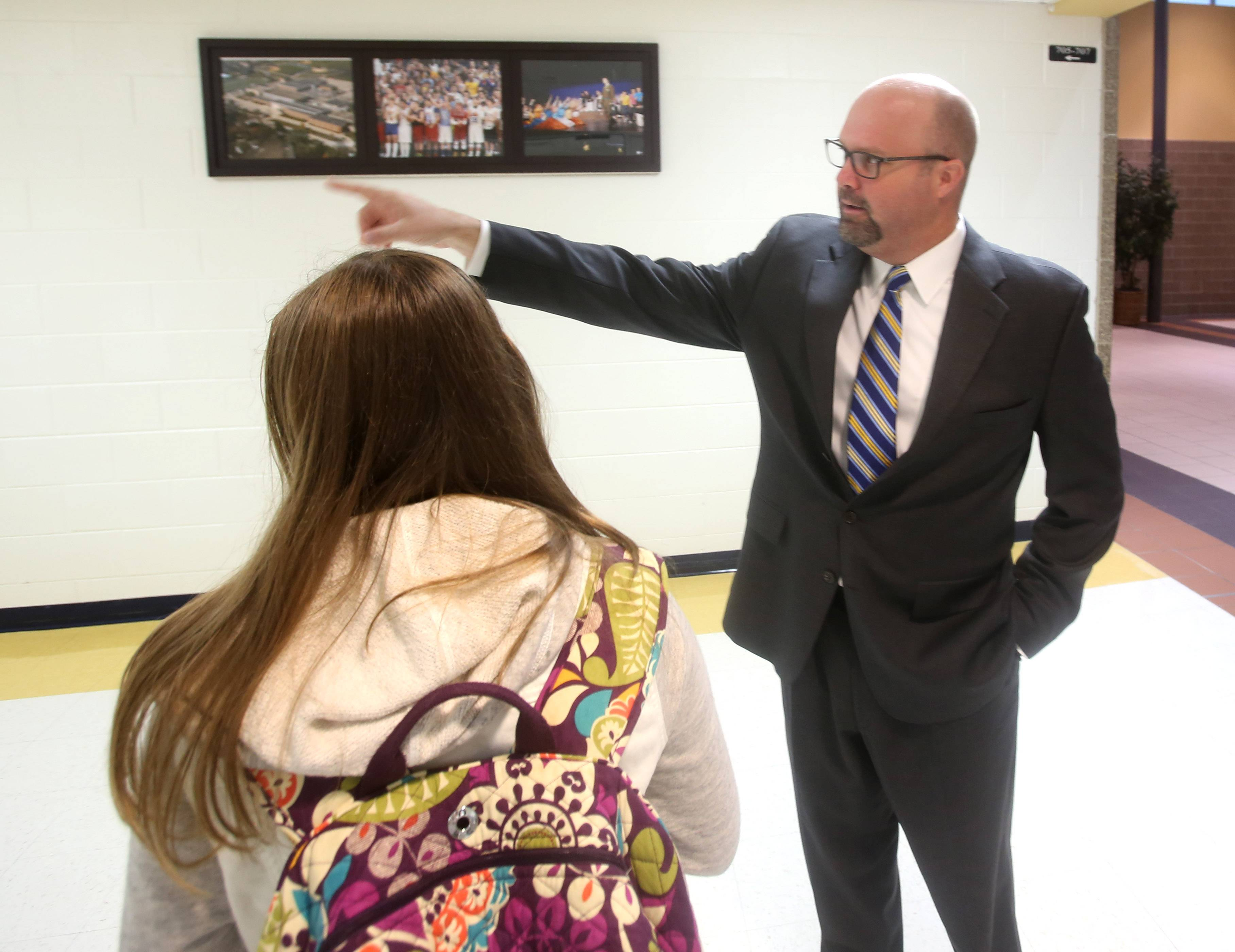 Wheaton North High School Principal Matt Biscan directs students in the right direction during the first day of classes.