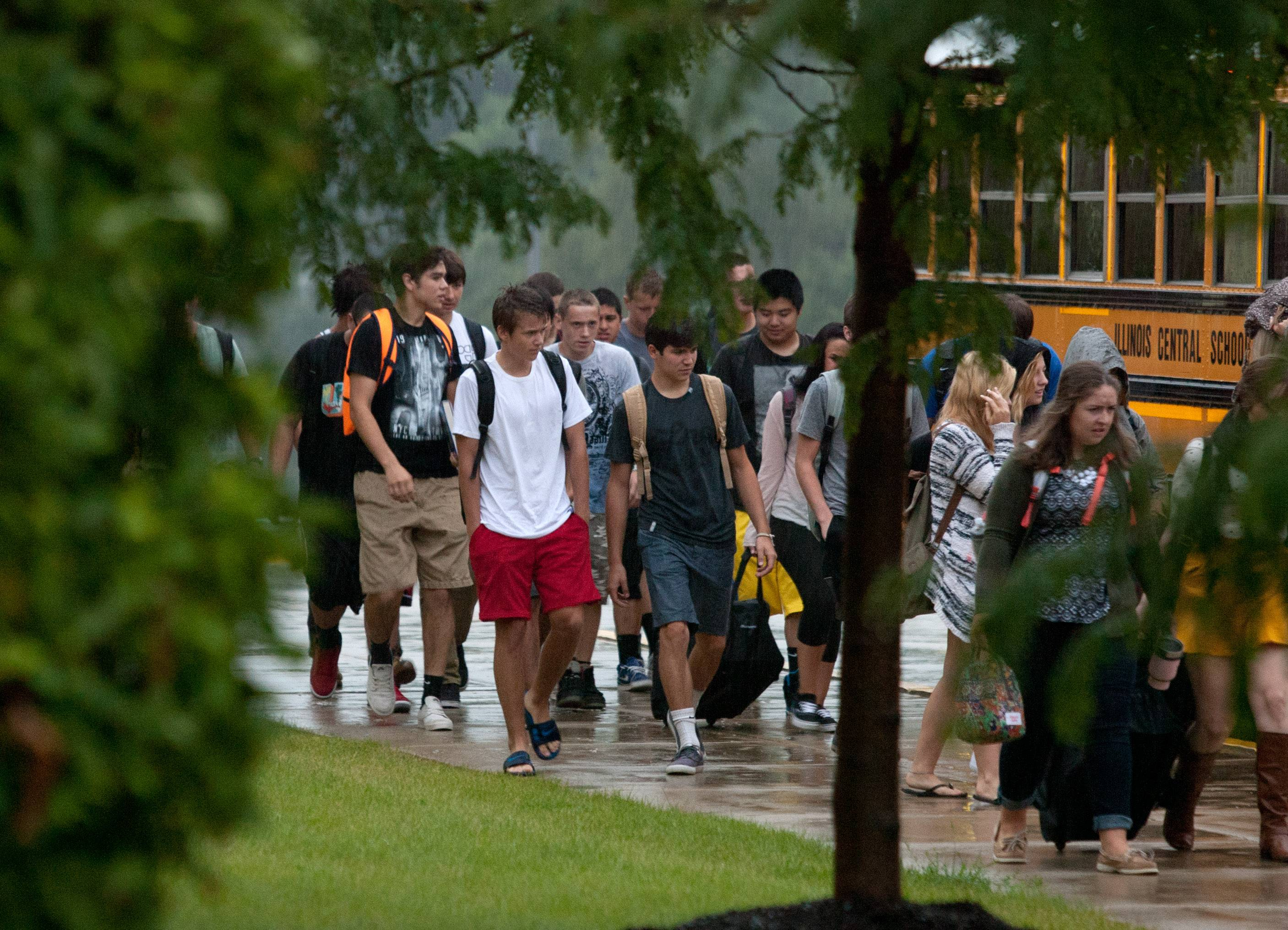 District 200 students battle a morning rain during the first day of classes at Wheaton North High School.