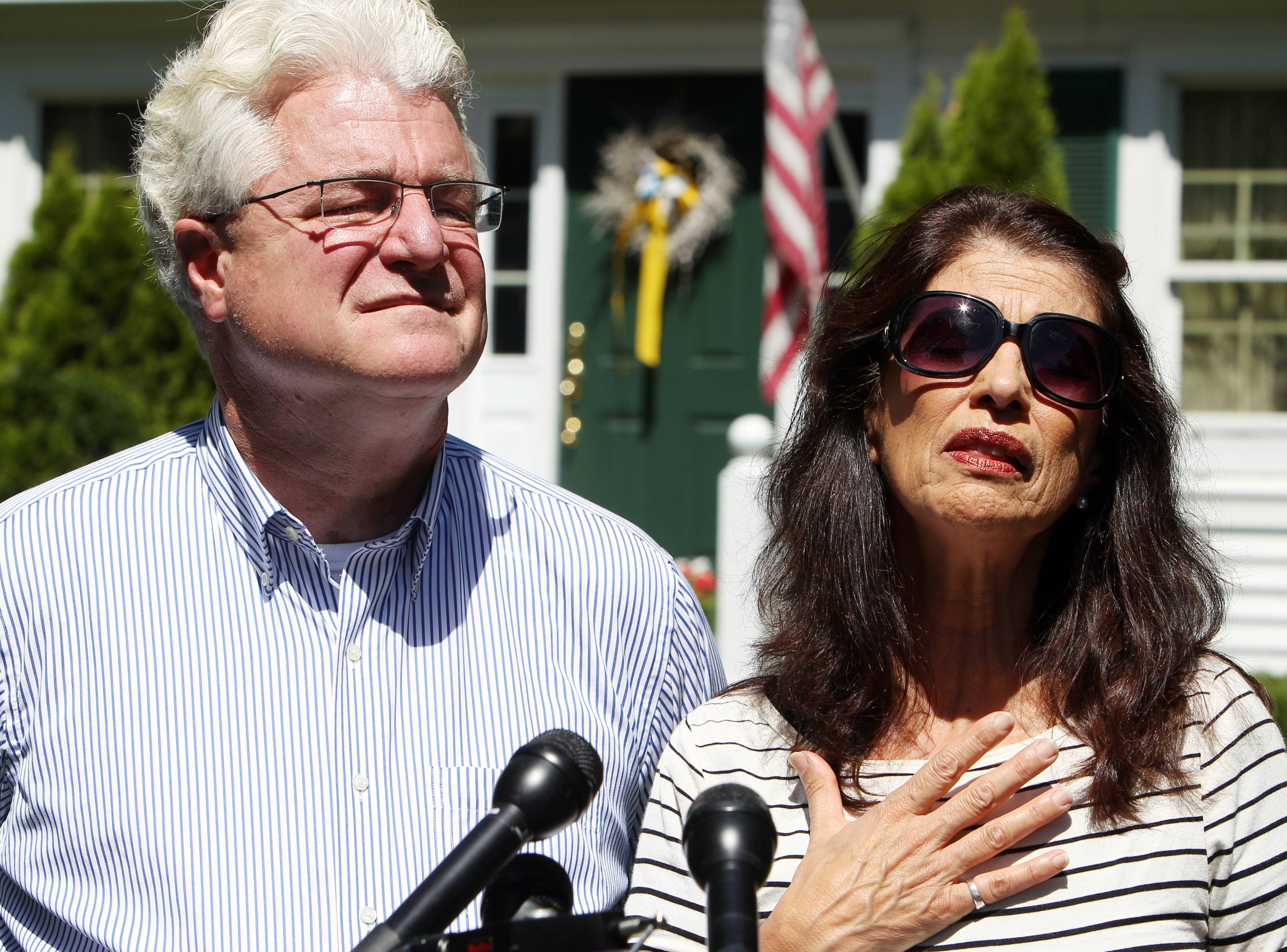 A U.S. official said that ransom demands for American journalist James Foley were sent to Diane and John Foley, seen here talking to reporters Wednesday.