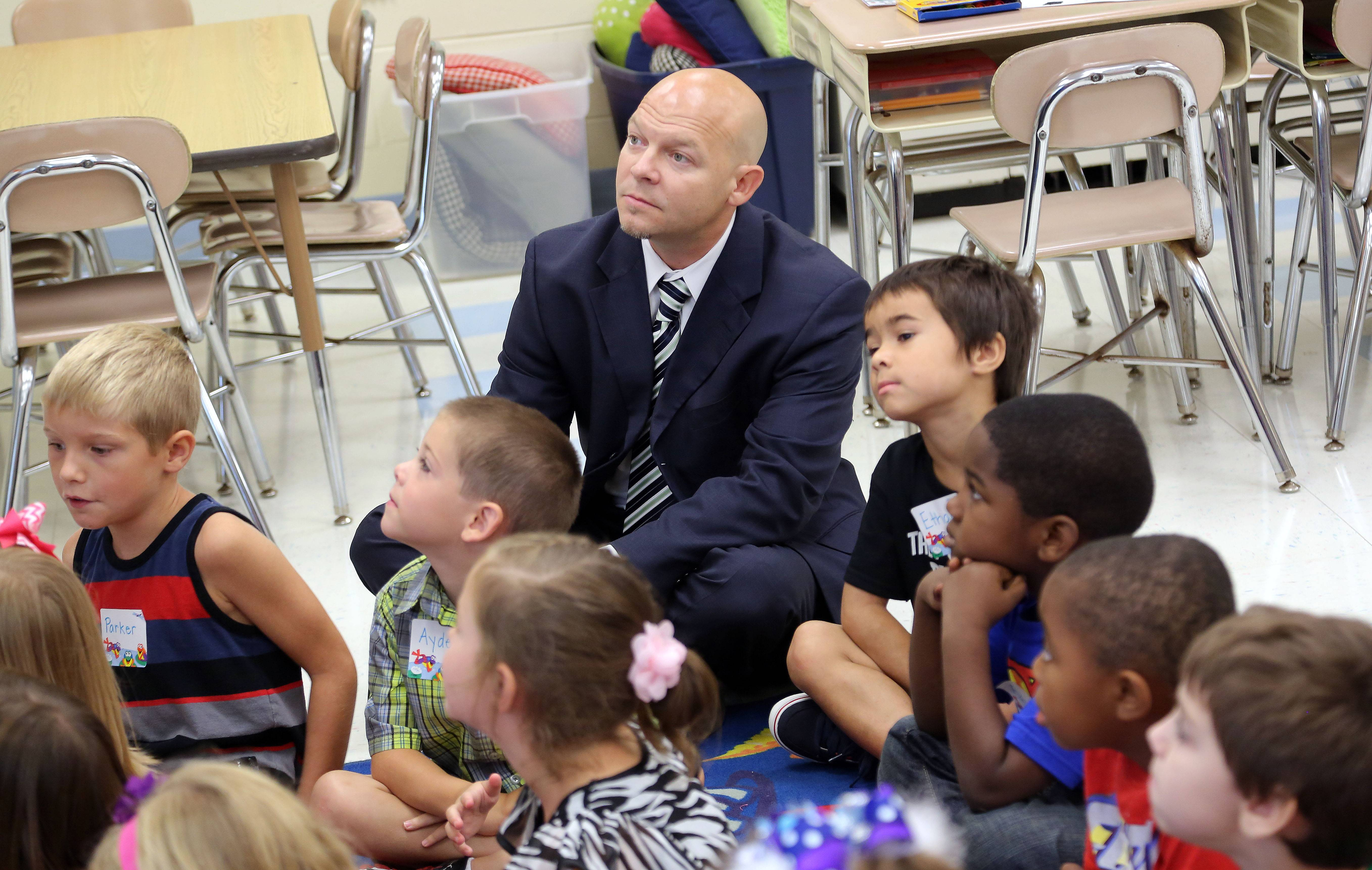 New Antioch Elementary District 34 Superintendent Jay Marino visits teacher Sarah Meyer's first grade class at Hillcrest Elementary School in Antioch on the first day of classes Thursday.