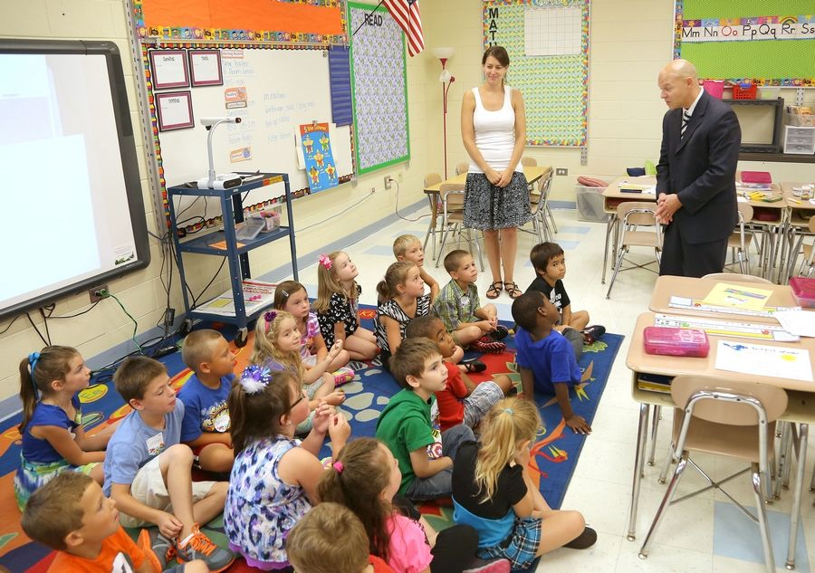 Jay Martino, right, the new superintendent in Antioch Elementary District 34, talks to teacher Sarah Meyer's first grade class at Hillcrest Elementary School on the first day of classes Thursday.