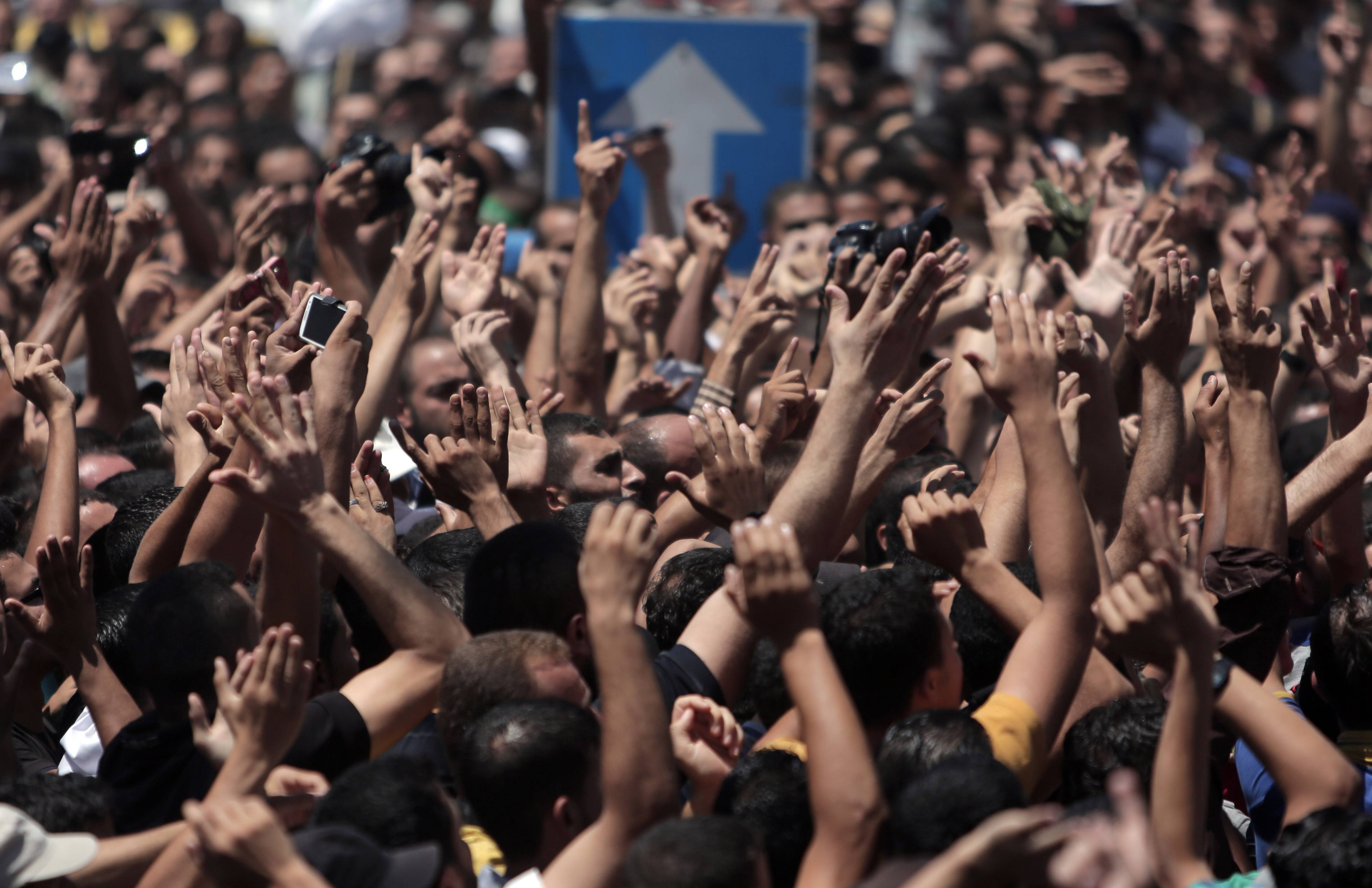 Palestinian mourners chant angry slogans as they attend the funeral of three senior commanders of the Hamas military wing who were killed in early morning Israeli strikes, in the Rafah refugee camp, Southern Gaza Strip, Thursday.