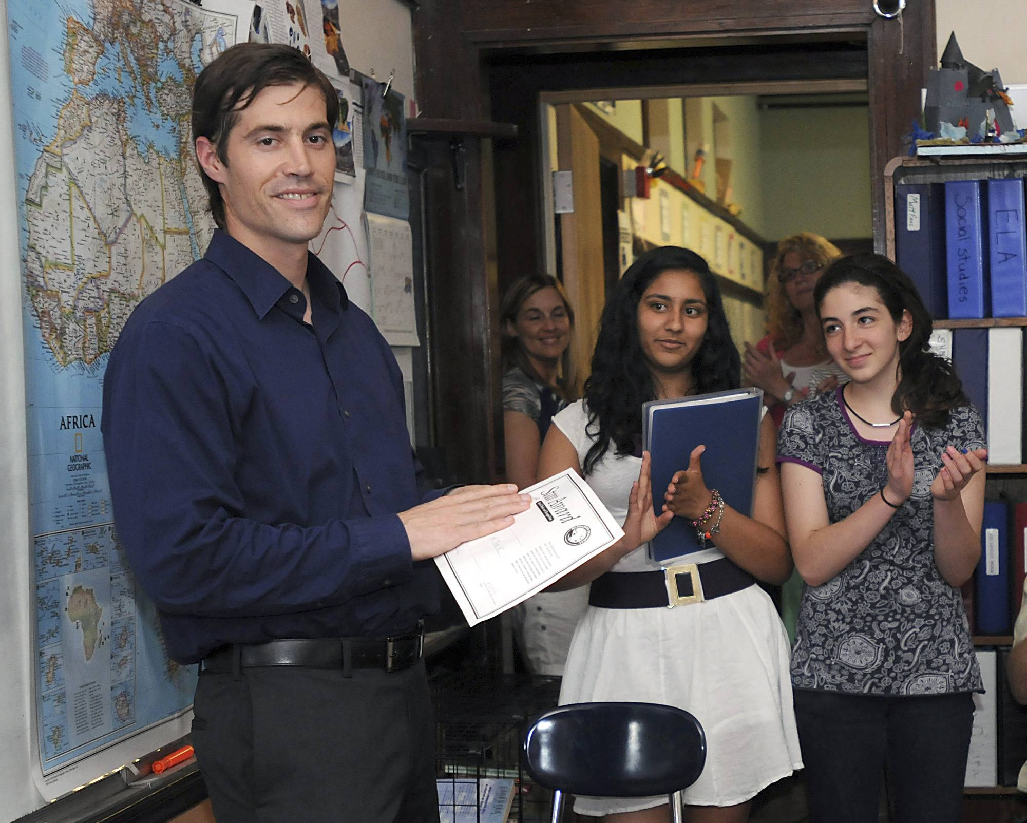 Journalist James Foley receives applause from students at the Christa McAuliffe Regional Charter Public School in Framingham, Mass. Foley had been released a month prior after being detained for six weeks in Libya. Students at the school had written government leaders to work for his release.